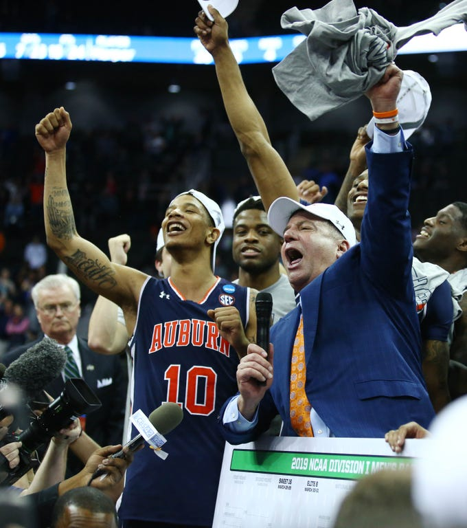 Mar 31, 2019; Kansas City, MO, United States; Auburn Tigers head coach Bruce Pearl and his players celebrate after defeating the Kentucky Wildcats in the championship game of the midwest regional of the 2019 NCAA Tournament at Sprint Center. Mandatory Credit: Jay Biggerstaff-USA TODAY Sports