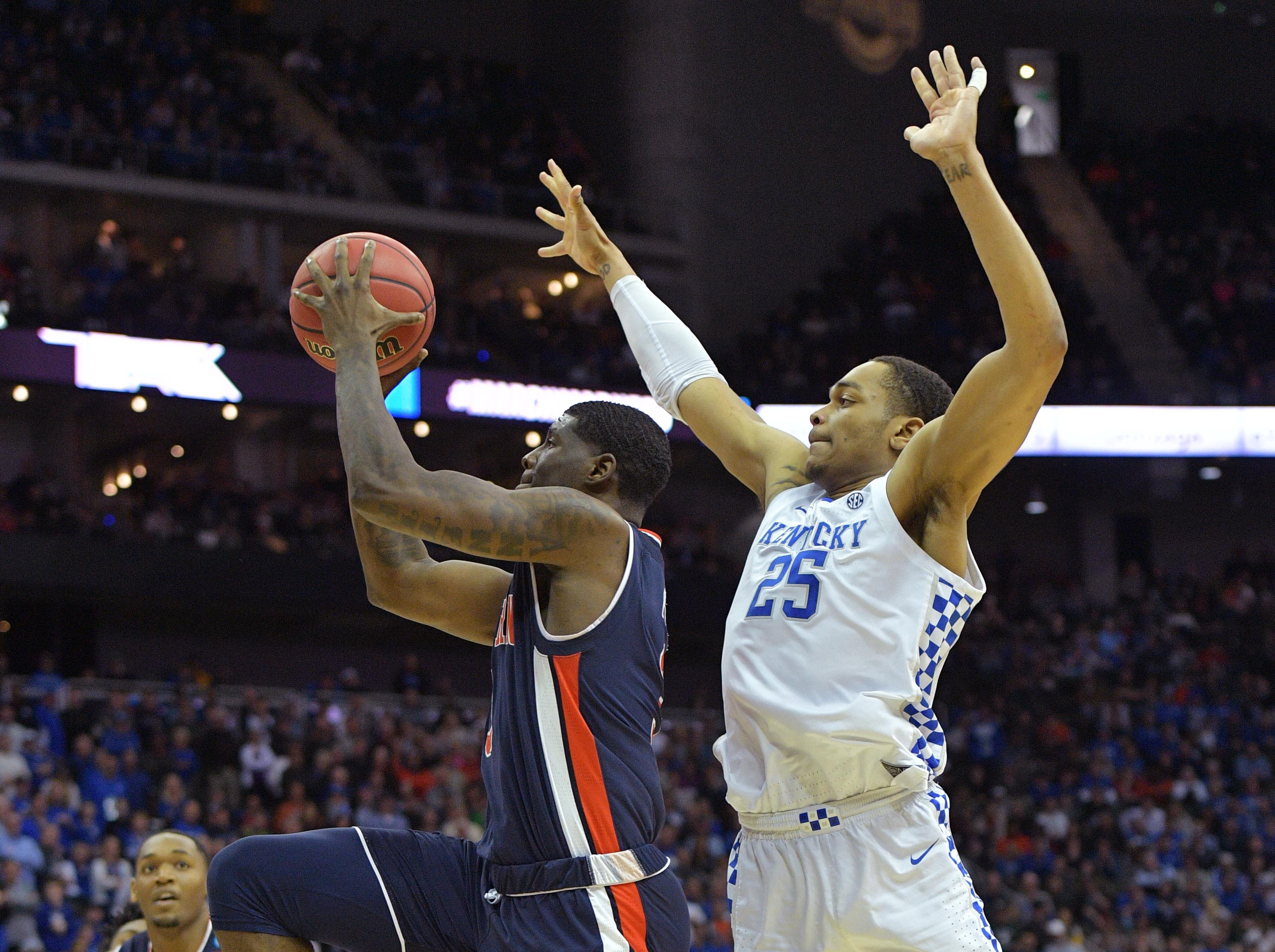 Mar 31, 2019; Kansas City, MO, United States; Auburn Tigers forward Danjel Purifoy (3) shoots against Kentucky Wildcats forward PJ Washington (25) during the second half in the championship game of the midwest regional of the 2019 NCAA Tournament at Sprint Center. Mandatory Credit: Denny Medley-USA TODAY Sports
