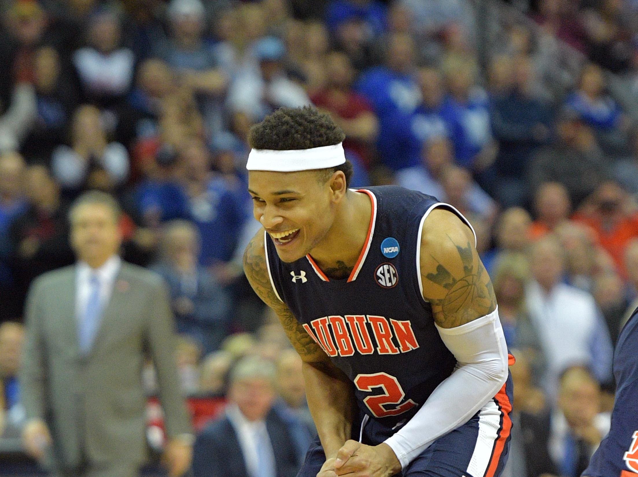 Mar 31, 2019; Kansas City, MO, United States; Auburn Tigers guard Bryce Brown (2) celebrates against the Kentucky Wildcats during overtime in the championship game of the midwest regional of the 2019 NCAA Tournament at Sprint Center. Mandatory Credit: Denny Medley-USA TODAY Sports