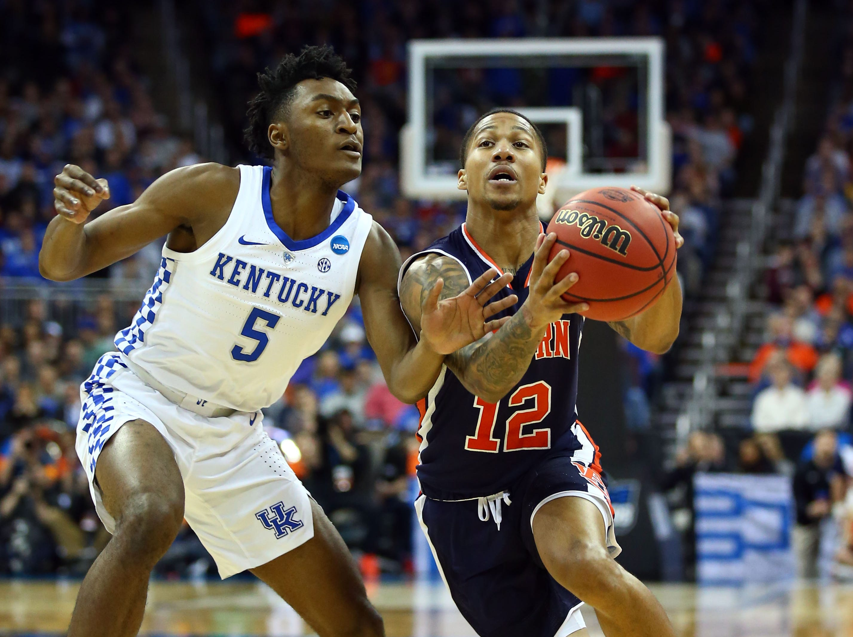 Mar 31, 2019; Kansas City, MO, United States; Auburn Tigers guard J'Von McCormick (12) drives to the basket against Kentucky Wildcats guard Immanuel Quickley (5) during the first half in the championship game of the midwest regional of the 2019 NCAA Tournament at Sprint Center. Mandatory Credit: Jay Biggerstaff-USA TODAY Sports