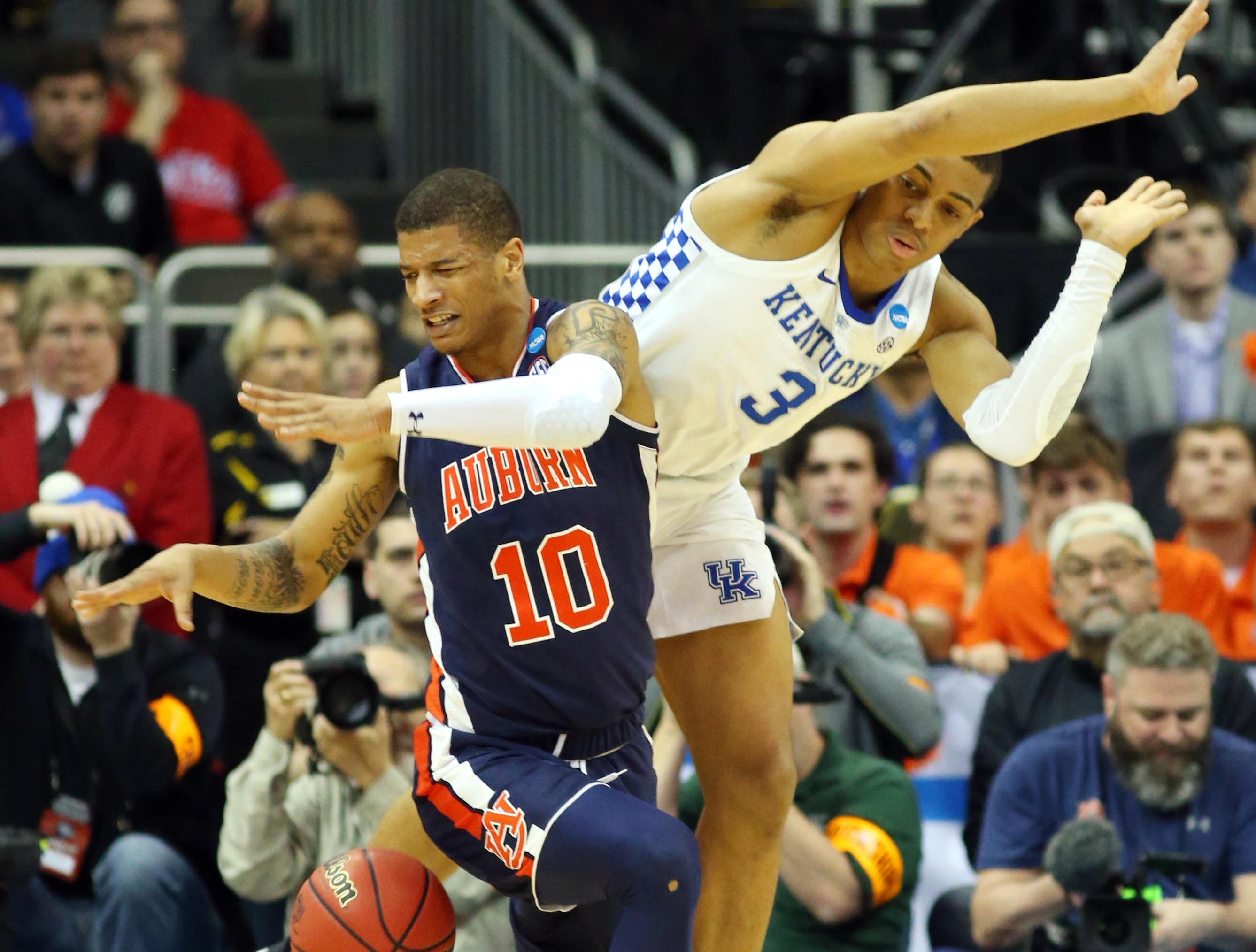Mar 31, 2019; Kansas City, MO, United States; Auburn Tigers guard Samir Doughty (10) collides with Kentucky Wildcats guard Keldon Johnson (3) during the second half in the championship game of the midwest regional of the 2019 NCAA Tournament at Sprint Center. Mandatory Credit: Jay Biggerstaff-USA TODAY Sports