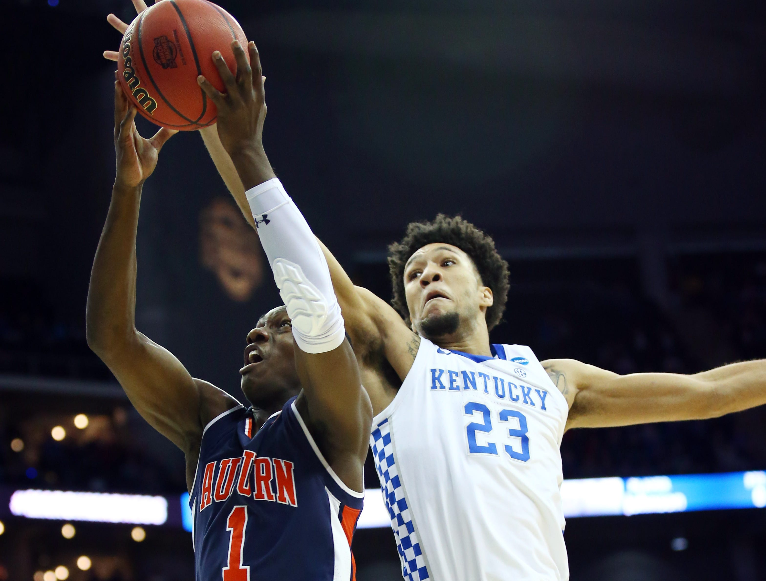 Mar 31, 2019; Kansas City, MO, United States; Auburn Tigers guard Jared Harper (1) shoots against Kentucky Wildcats forward EJ Montgomery (23) during the first half in the championship game of the midwest regional of the 2019 NCAA Tournament at Sprint Center. Mandatory Credit: Jay Biggerstaff-USA TODAY Sports
