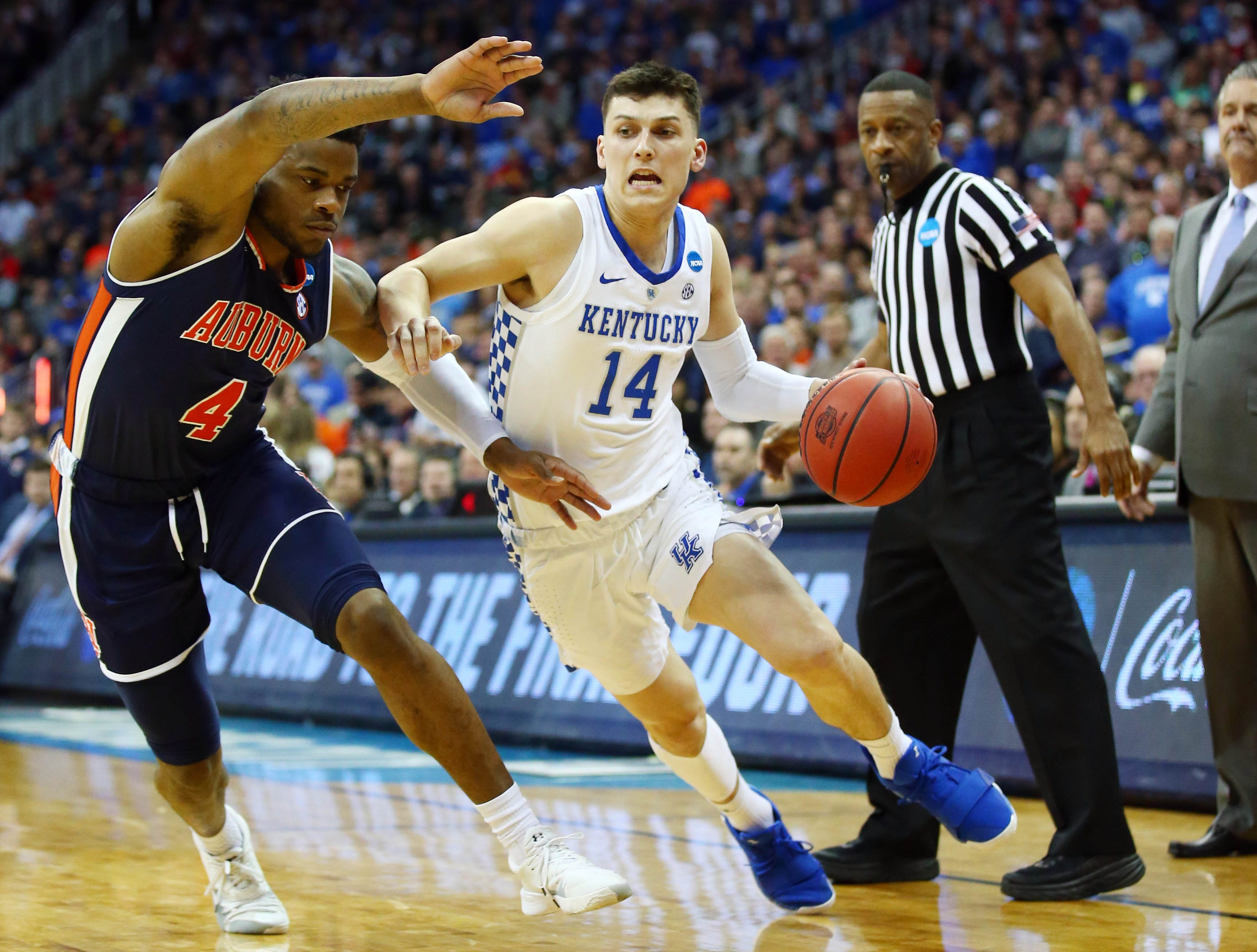 Mar 31, 2019; Kansas City, MO, United States; Kentucky Wildcats guard Tyler Herro (14) dribbles againt Auburn Tigers guard Malik Dunbar (4) during the second half in the championship game of the midwest regional of the 2019 NCAA Tournament at Sprint Center. Mandatory Credit: Jay Biggerstaff-USA TODAY Sports