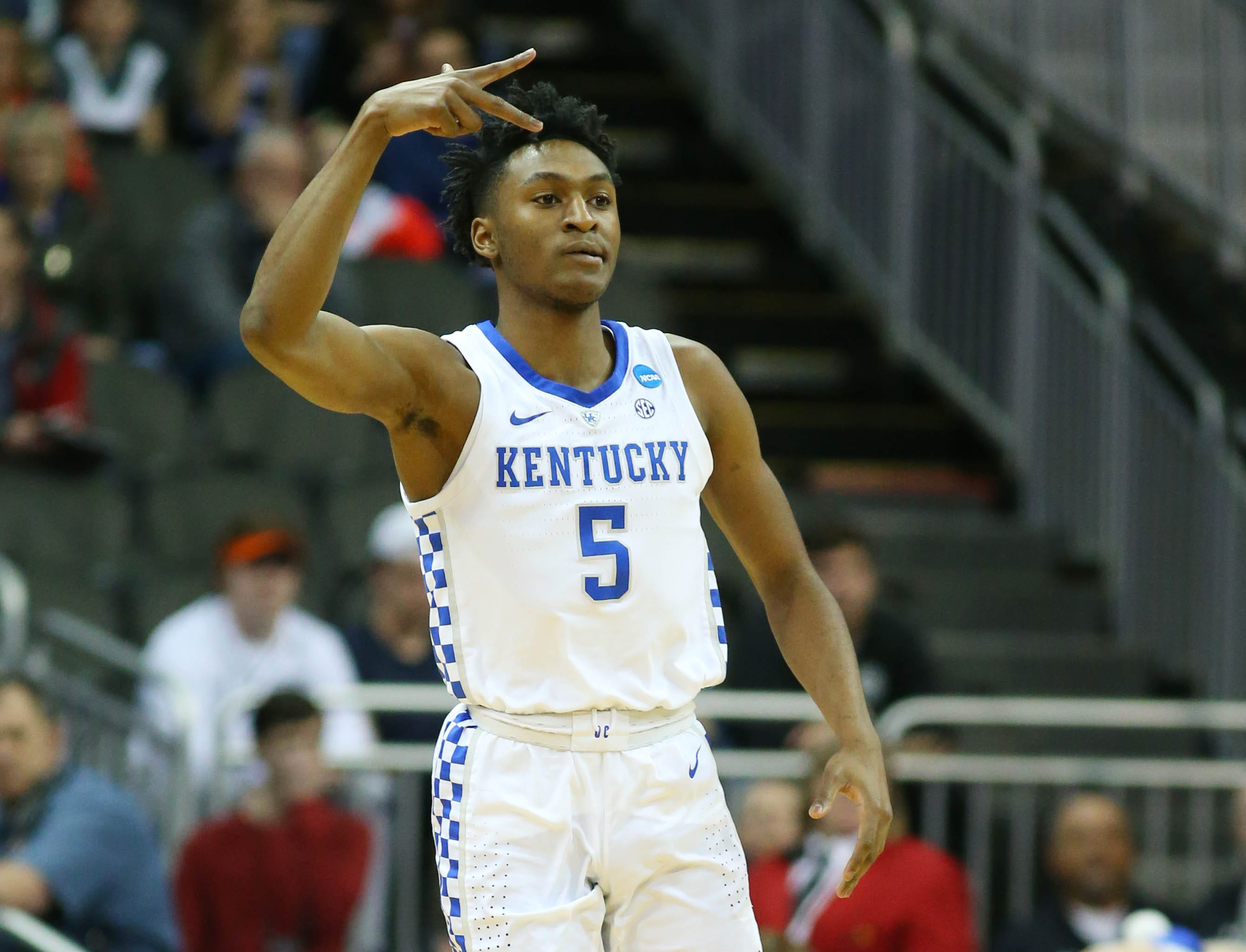 Mar 31, 2019; Kansas City, MO, United States; Kentucky Wildcats guard Immanuel Quickley (5) reacts after a basket against the Auburn Tigers during the first half in the championship game of the midwest regional of the 2019 NCAA Tournament at Sprint Center. Mandatory Credit: Jay Biggerstaff-USA TODAY Sports