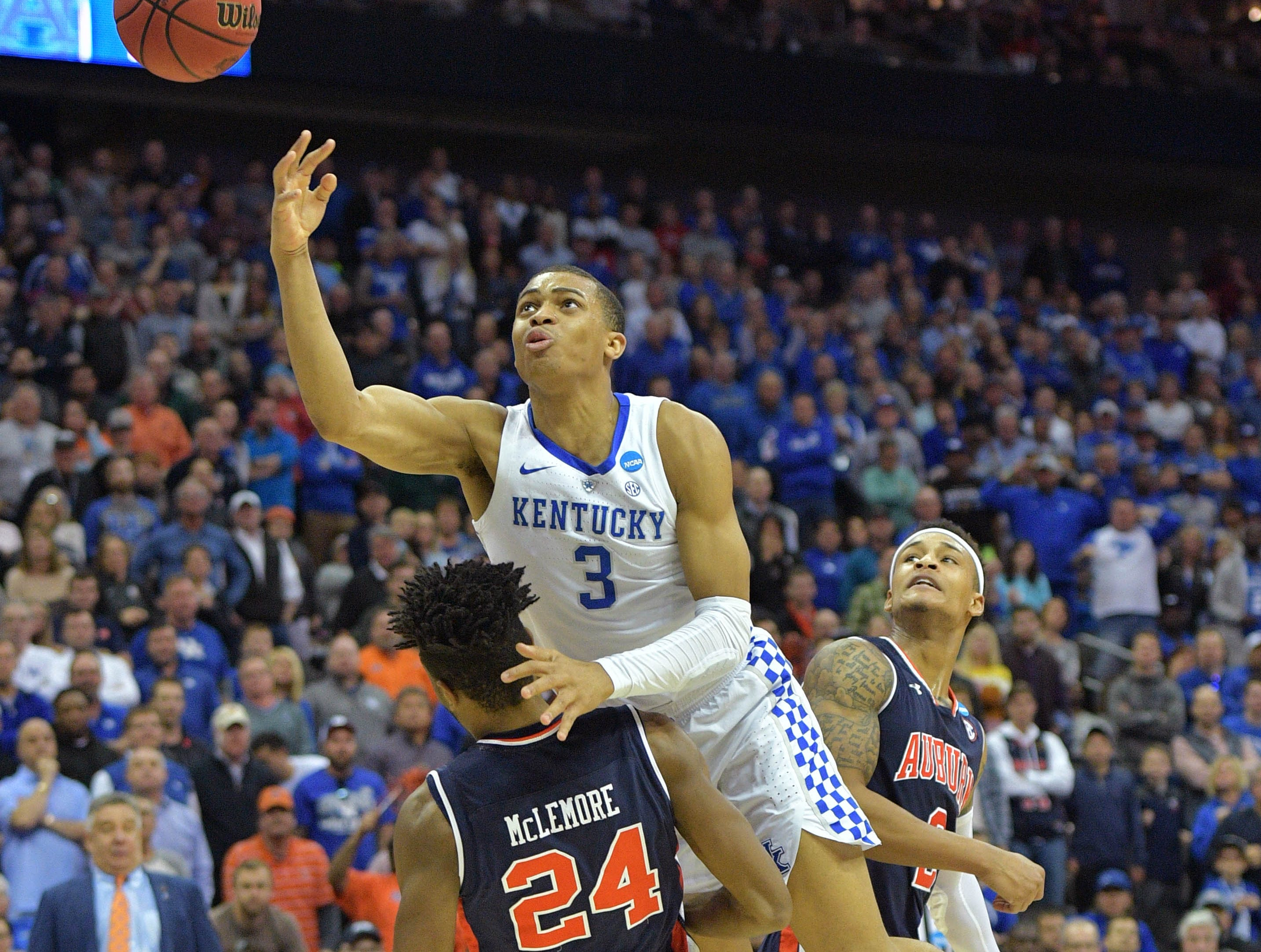 Mar 31, 2019; Kansas City, MO, United States; Kentucky Wildcats guard Keldon Johnson (3) shoots between Auburn Tigers guard Bryce Brown (2) and forward Anfernee McLemore (24) during the first half in the championship game of the midwest regional of the 2019 NCAA Tournament at Sprint Center. Mandatory Credit: Denny Medley-USA TODAY Sports
