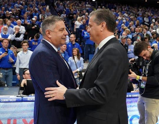 Kentucky head coach John Calipari and Auburn head coach Bruce Pearl shake hands before a game at Rupp Arena on Feb. 23, 2019, in Lexington, Ky.