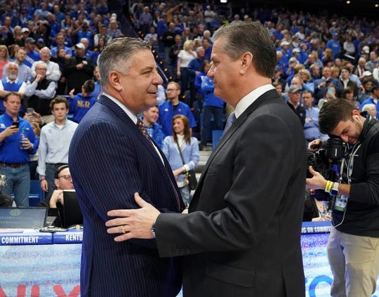 Kentucky head coach John Calipari and Auburn head coach Bruce Pearl shake hands before a game at Rupp Arena on Feb. 23, 2019, in Lexington, Ky.