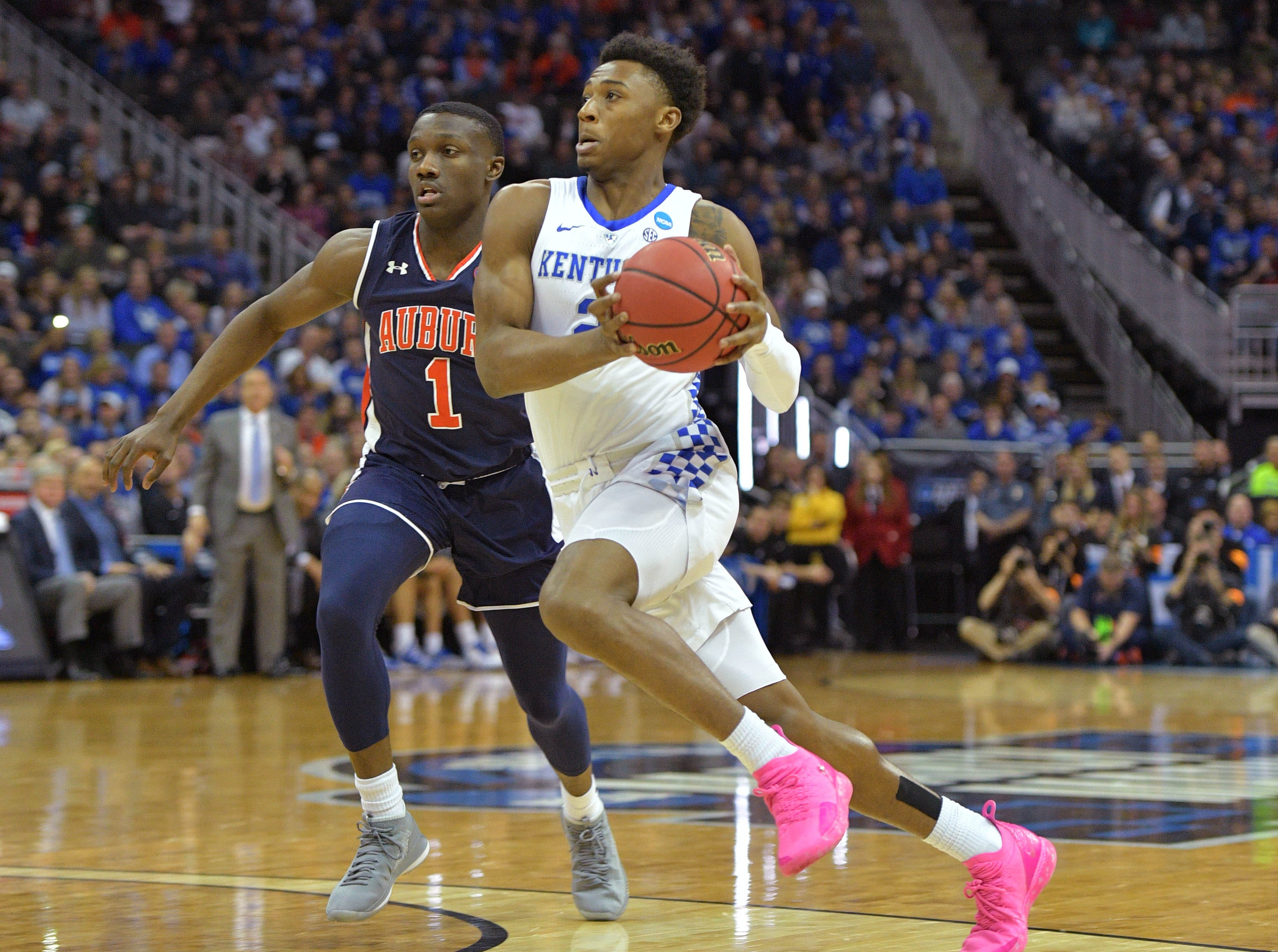 Mar 31, 2019; Kansas City, MO, United States; Kentucky Wildcats guard Ashton Hagans (2) drives past Auburn Tigers guard Jared Harper (1) during the first half in the championship game of the midwest regional of the 2019 NCAA Tournament at Sprint Center. Mandatory Credit: Denny Medley-USA TODAY Sports