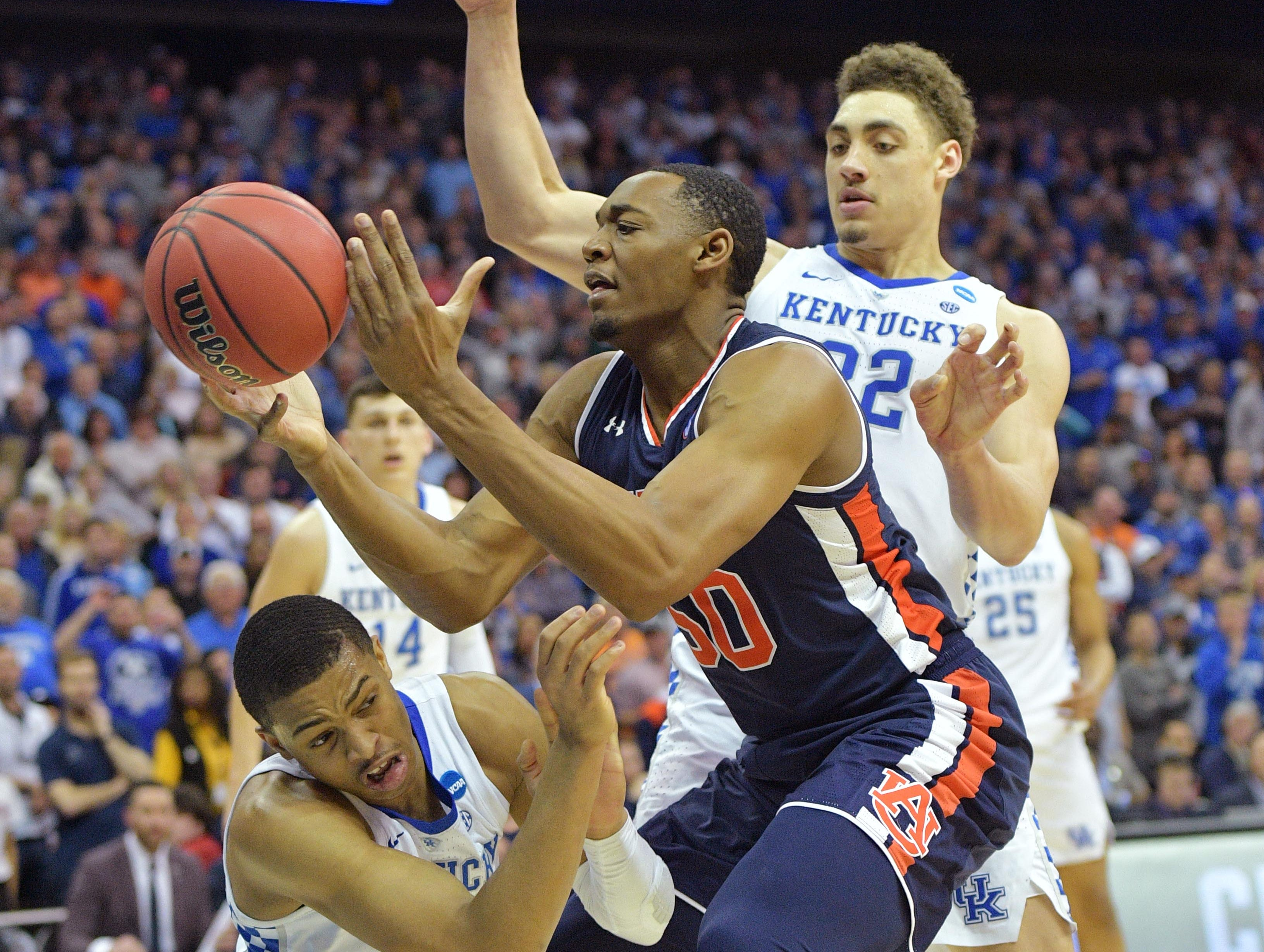 Mar 31, 2019; Kansas City, MO, United States; Auburn Tigers center Austin Wiley (50) looks to shoot between Kentucky Wildcats forward Reid Travis (22) and guard Keldon Johnson (3) during the second half in the championship game of the midwest regional of the 2019 NCAA Tournament at Sprint Center. Mandatory Credit: Denny Medley-USA TODAY Sports