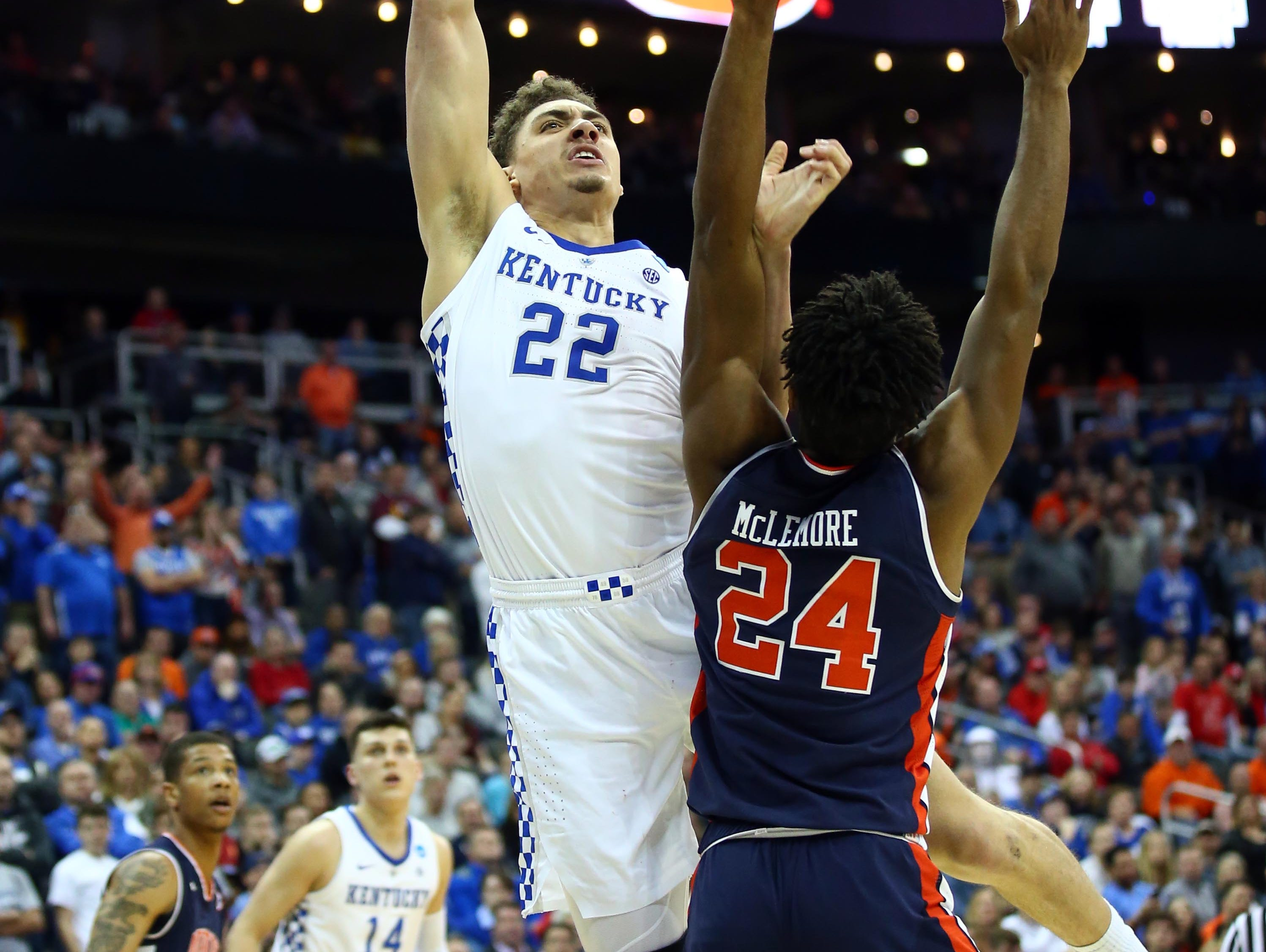 Mar 31, 2019; Kansas City, MO, United States; Kentucky Wildcats forward Reid Travis (22) shoots over Auburn Tigers forward Anfernee McLemore (24) during the second half in the championship game of the midwest regional of the 2019 NCAA Tournament at Sprint Center. Mandatory Credit: Jay Biggerstaff-USA TODAY Sports