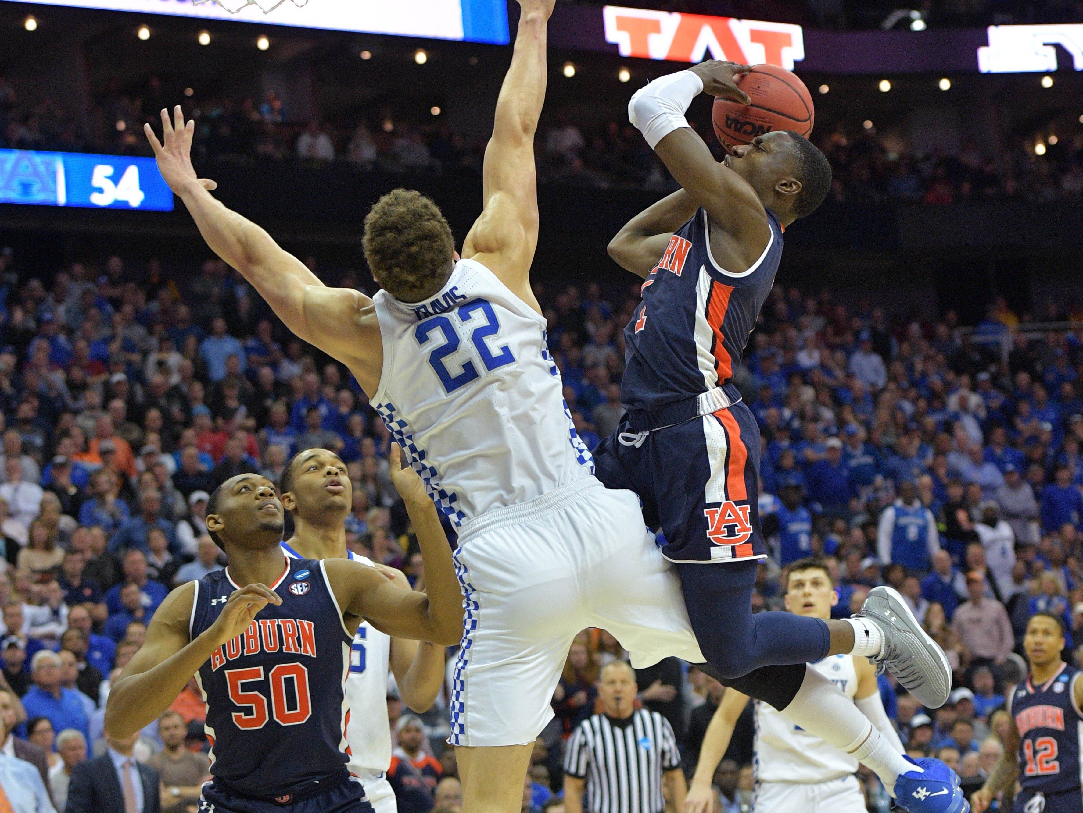 Mar 31, 2019; Kansas City, MO, United States; Auburn Tigers guard Jared Harper (1) shoots over Kentucky Wildcats forward Reid Travis (22) during the second half in the championship game of the midwest regional of the 2019 NCAA Tournament at Sprint Center. Mandatory Credit: Denny Medley-USA TODAY Sports