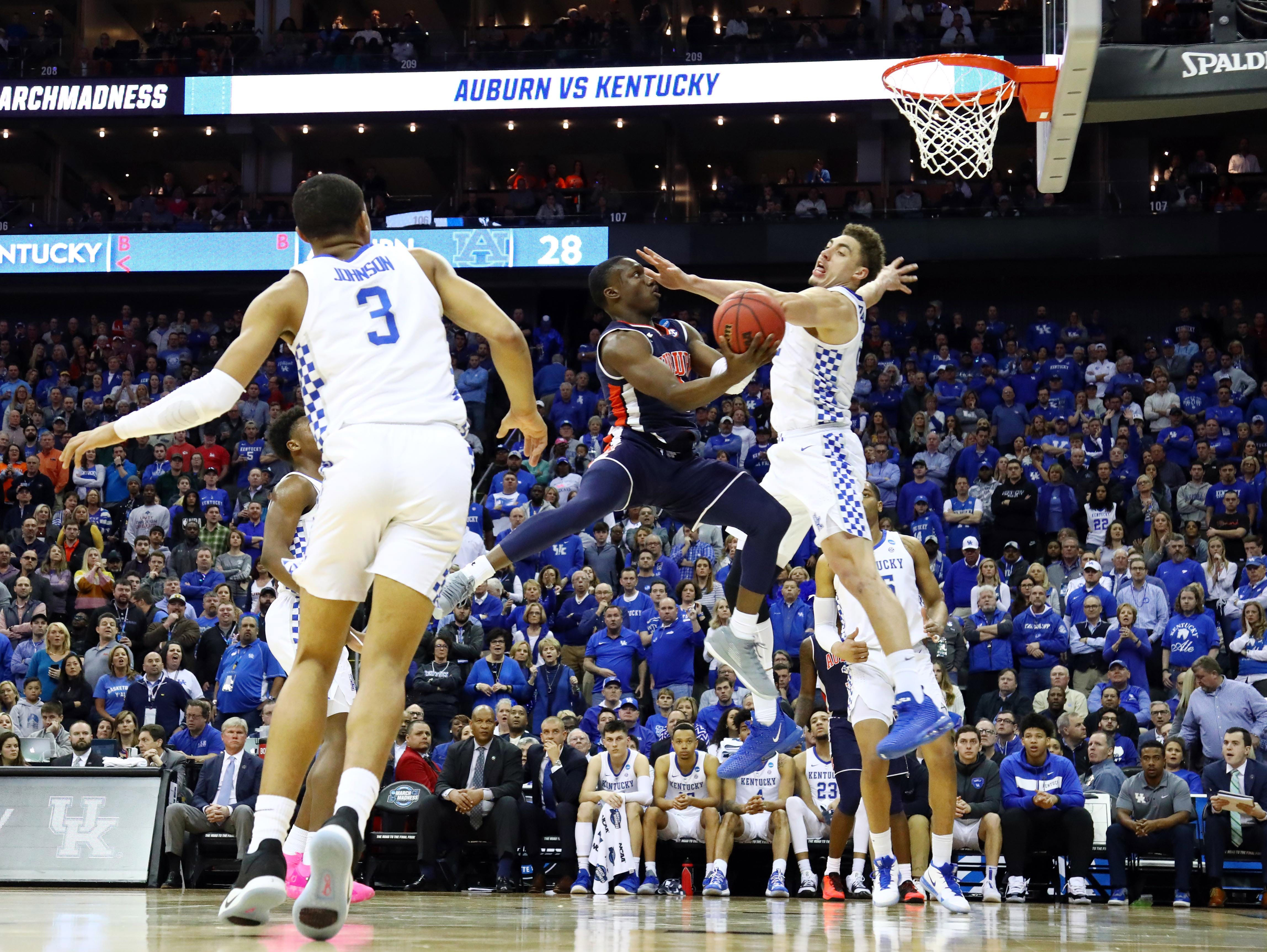 Mar 31, 2019; Kansas City, MO, United States; Auburn Tigers guard Jared Harper (1) shoots against Kentucky Wildcats forward Reid Travis (22) during the first half in the championship game of the midwest regional of the 2019 NCAA Tournament at Sprint Center. Mandatory Credit: Jay Biggerstaff-USA TODAY Sports