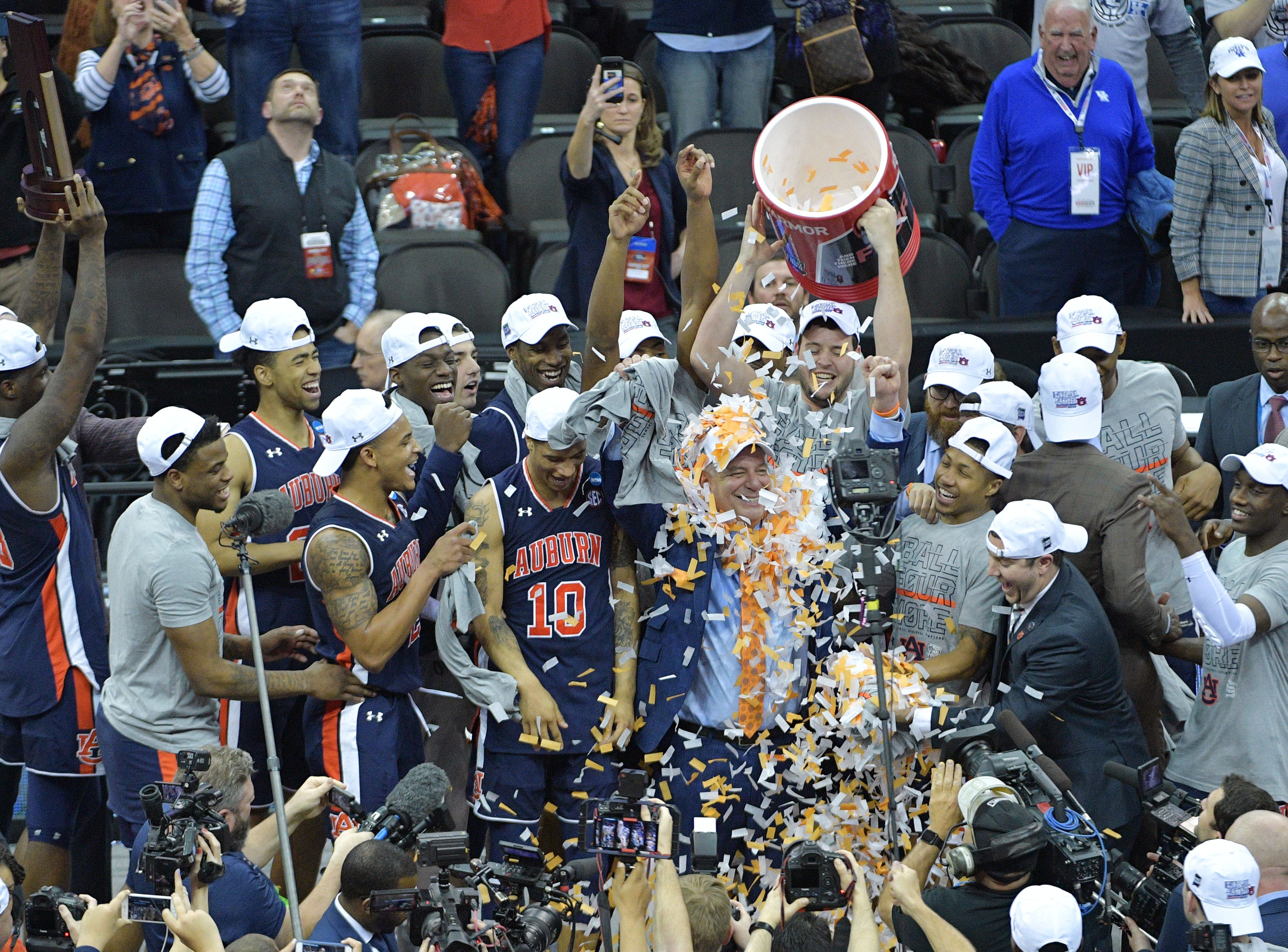 Mar 31, 2019; Kansas City, MO, United States; Auburn Tigers head coach Bruce Pearl gets confetti dumped on his head after defeating the Kentucky Wildcats in the championship game of the midwest regional of the 2019 NCAA Tournament at Sprint Center. Mandatory Credit: Denny Medley-USA TODAY Sports