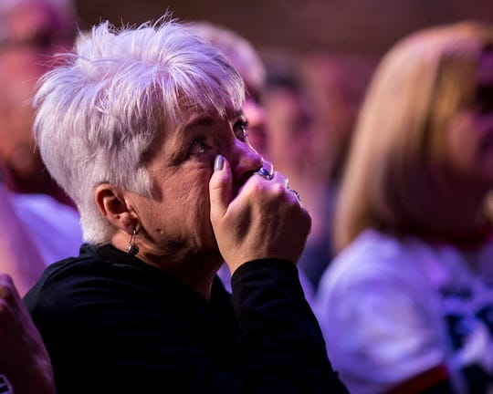 Kelly Holiday reacts as she watches a video about the Free Mom Hugs movement at GracePointe Church in Nashville on Sunday, March 31, 2019.