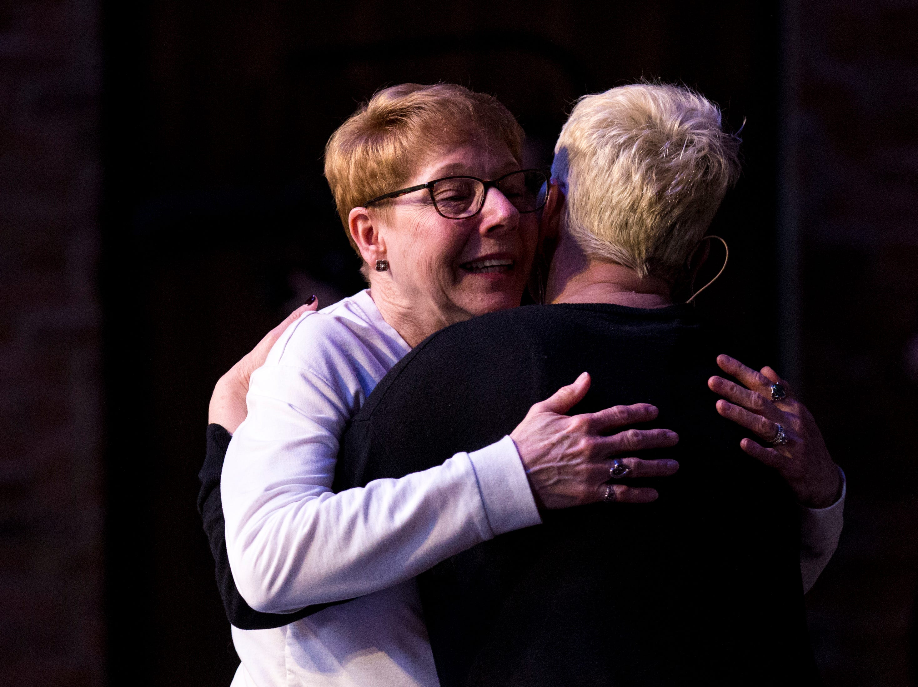 Liz Dyer hugs Sara Cunningham at GracePointe Church in Nashville on Sunday, March 31, 2019. Cunningham spoke about her journey to accepting her son as a gay man while keeping her faith.