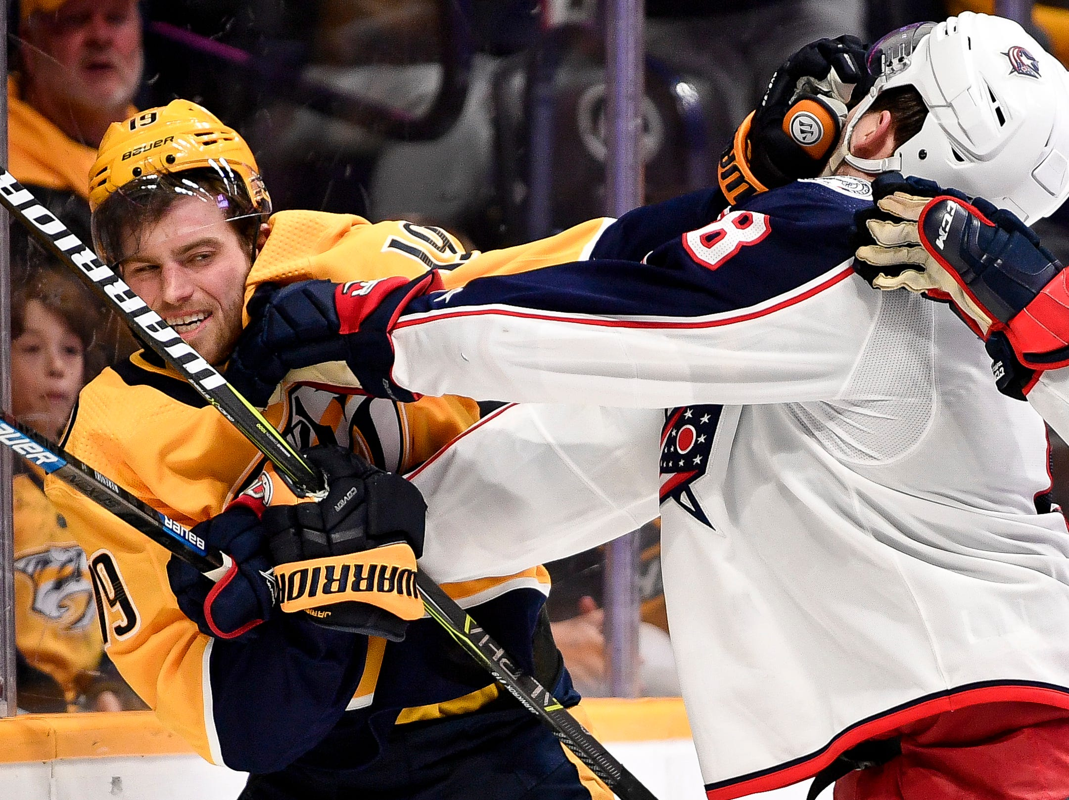 March 30, 2019 - Blue Jackets 5, Predators 2: Nashville Predators center Calle Jarnkrok (19) scuffles with Columbus Blue Jackets defenseman Zach Werenski (8) during the third period at Bridgestone Arena in Nashville, Tenn., Saturday, March 30, 2019.