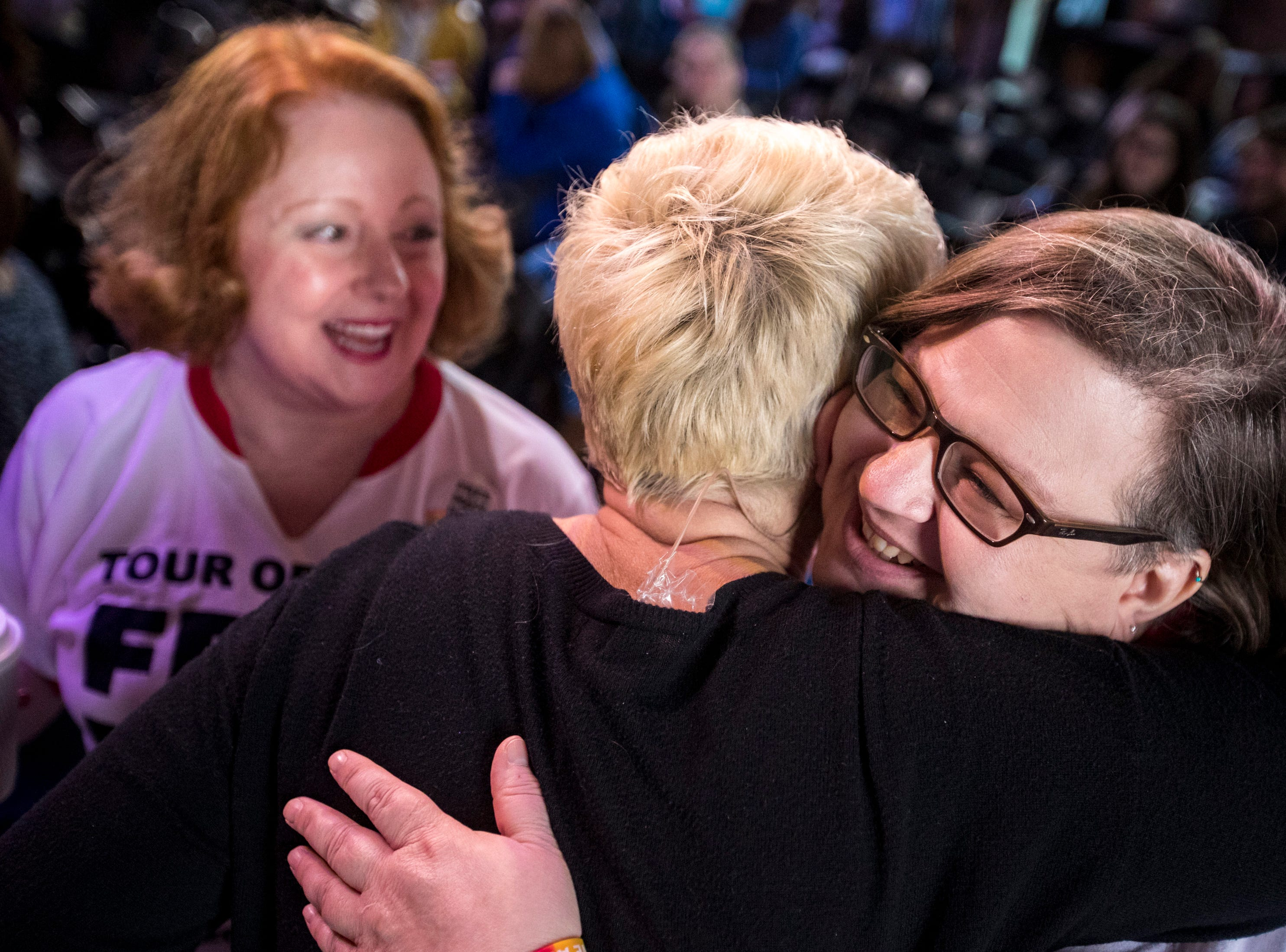 """Mama bear"" Stacy Drake gets a hug from Sara Cunningham before Cunningham speaks at GracePointe Church in Nashville on Sunday, March 31, 2019. Cunningham spoke about her journey to accepting her son as a gay man while keeping her faith."