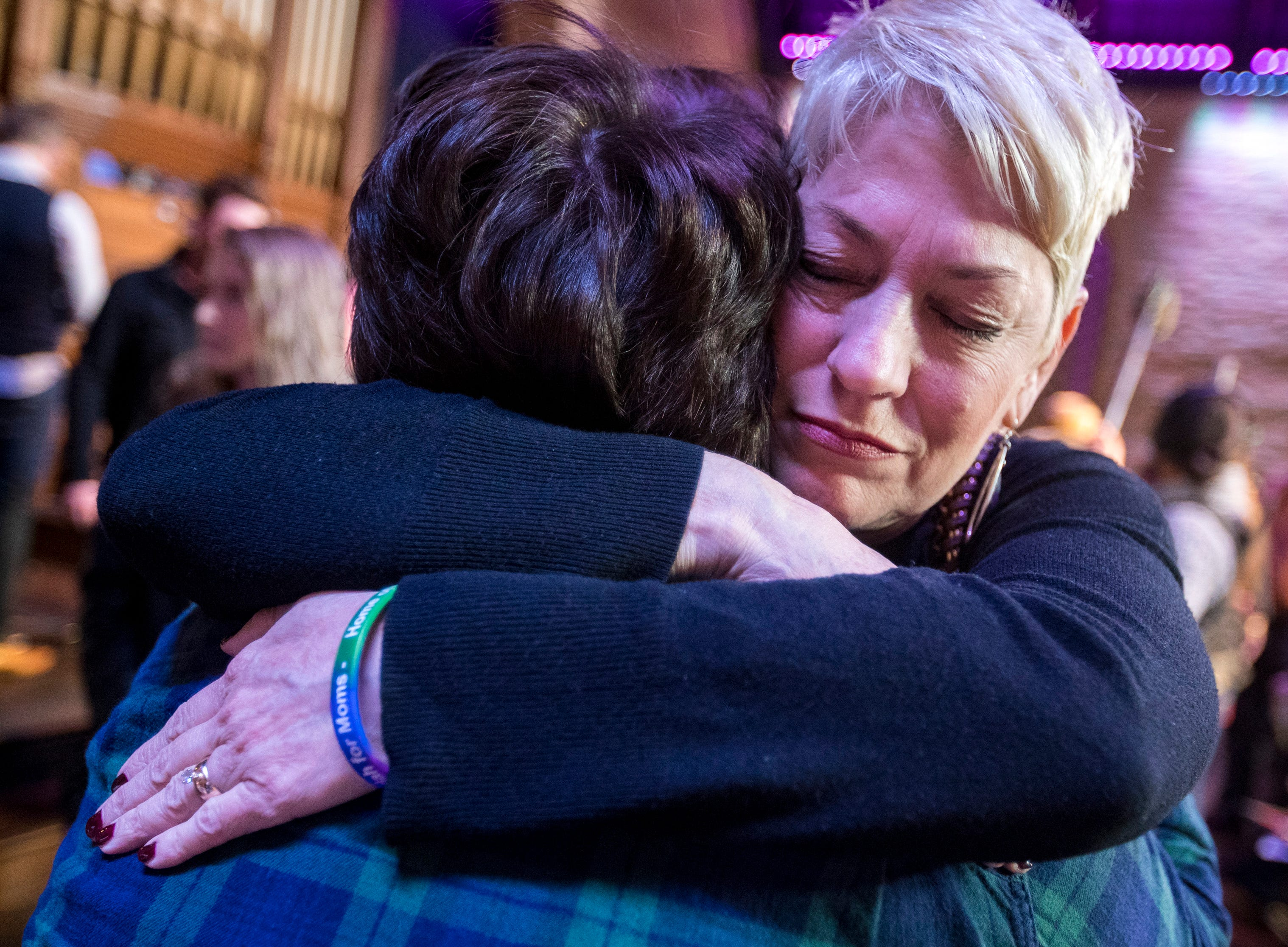 Sara Cunningham hugs Emily Wilkerson at GracePointe Church in Nashville on Sunday, March 31, 2019. Cunningham spoke about her journey to accepting her son as a gay man while keeping her faith.