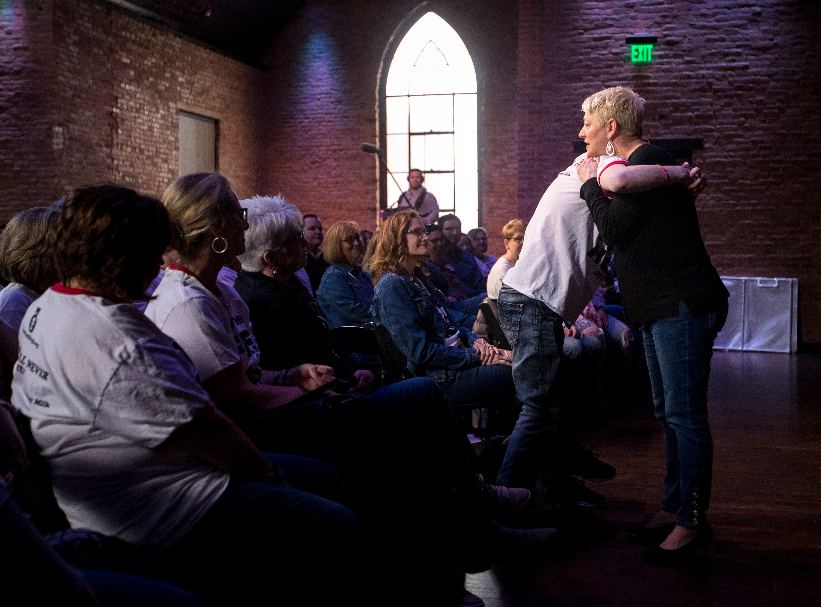 Sara Cunningham hugs an audience member at GracePointe Church in Nashville on Sunday, March 31, 2019. Cunningham spoke about her journey to accepting her son as a gay man while keeping her faith.