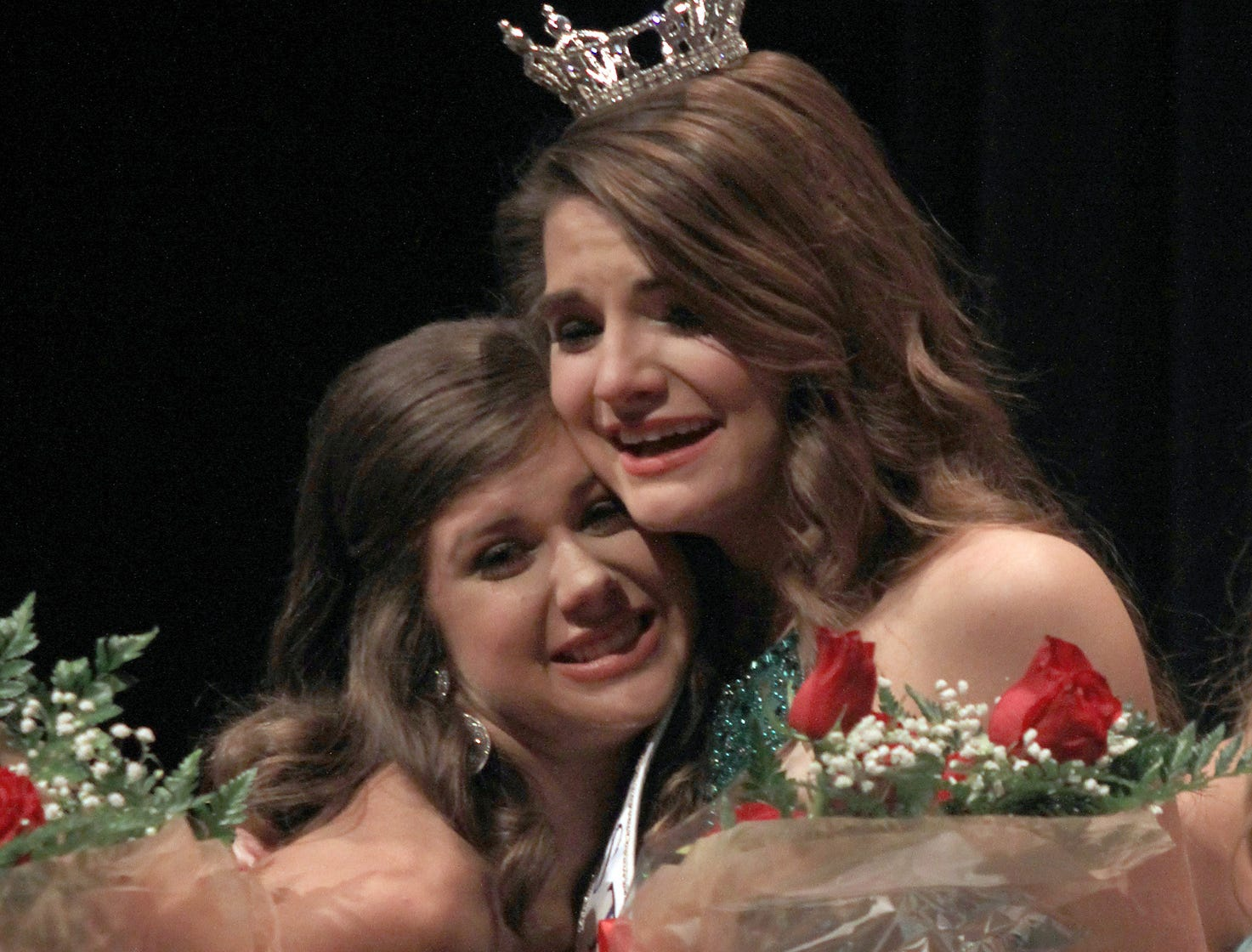 Kinsley Burchett gives a hug to the newly crowned Miss Tennessee's Outstanding Teen 2019 Taylor Parsons in Gallatin, TN on Saturday, March 30, 2019.