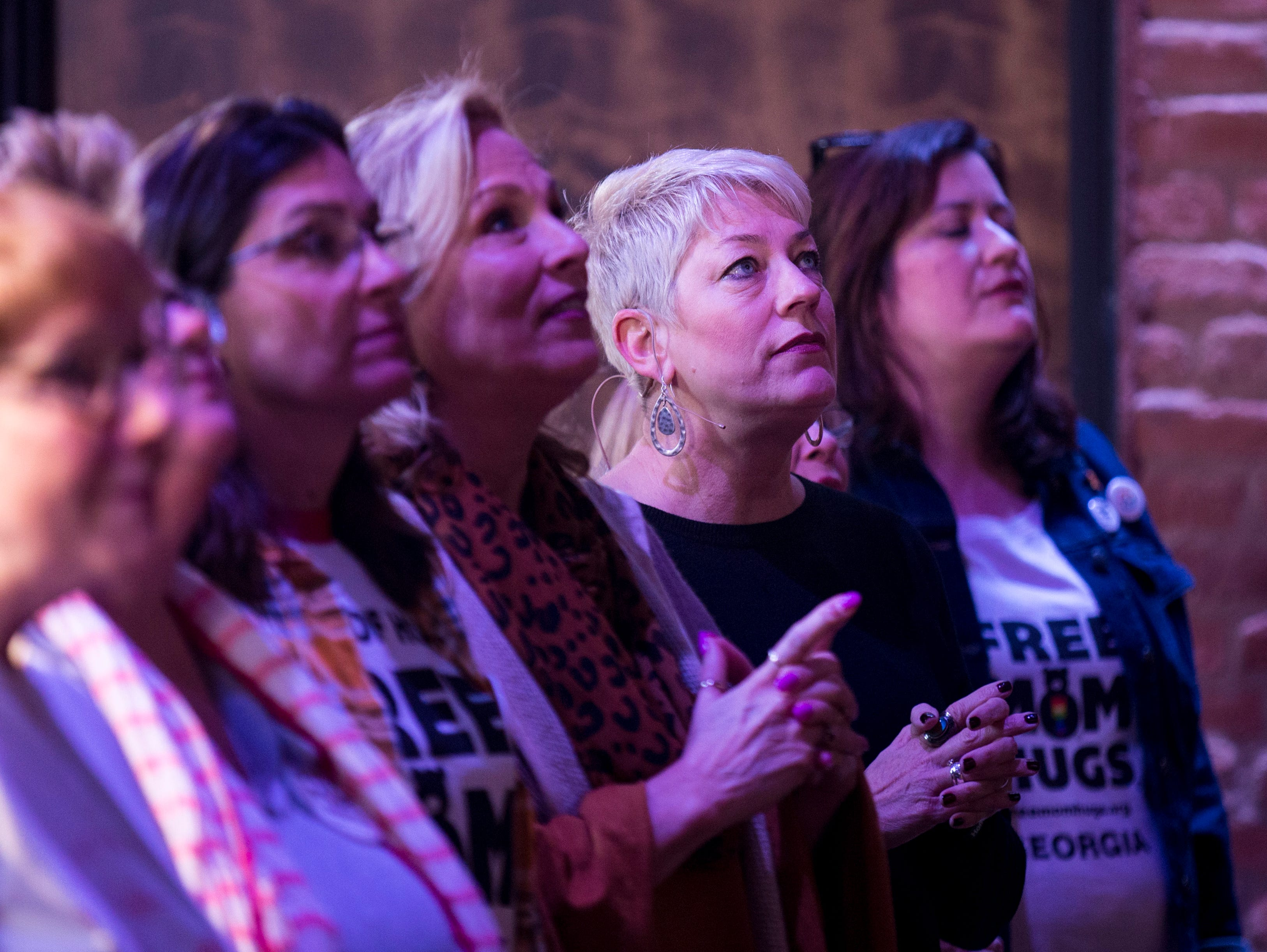 Sara Cunningham listens as the praise band performs, before speaking at GracePointe Church in Nashville on Sunday, March 31, 2019. Cunningham spoke about her journey to accepting her son as a gay man while keeping her faith.