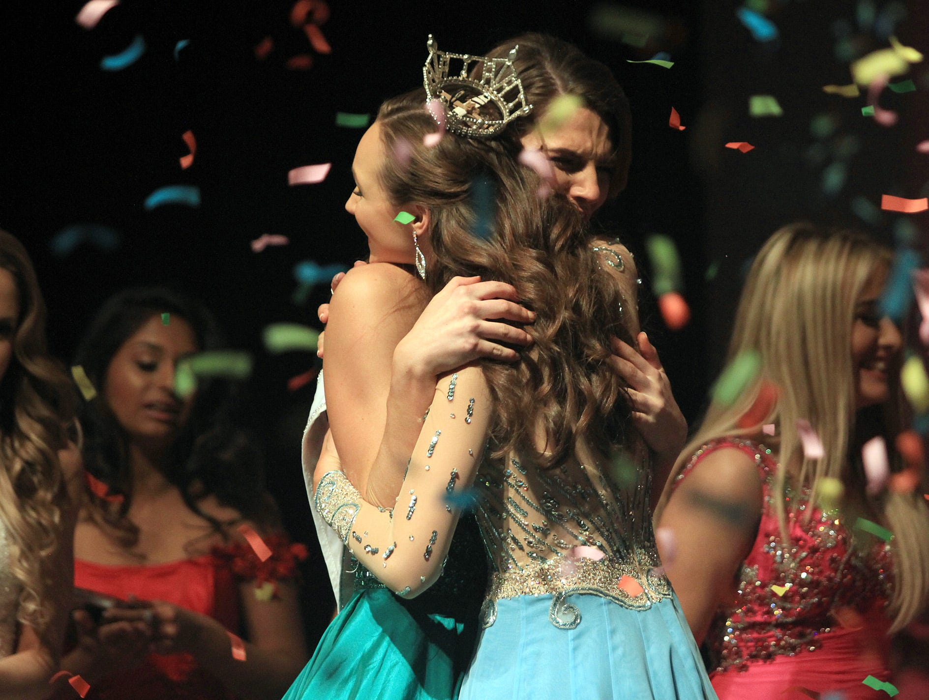 The confetti flies as Taylor Parsons gets a hug from Mary Humphreys after being crowned Miss Tennessee's Outstanding Teen 2019 in Gallatin, TN on Saturday, March 30, 2019.