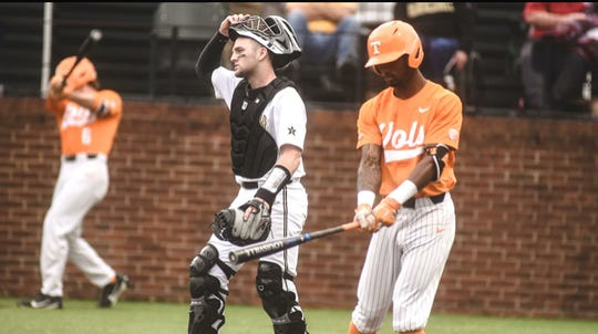 Vanderbilt catcher Philip Clarke looks on before Tennessee's Alerick Soularie steps up to bat in Saturday's game.