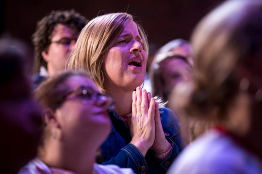 An audience member reacts as the praise band performs before Sara Cunningham speaks at GracePointe Church in Nashville on Sunday, March 31, 2019. Cunningham spoke about her journey to accepting her son as a gay man while keeping her faith.