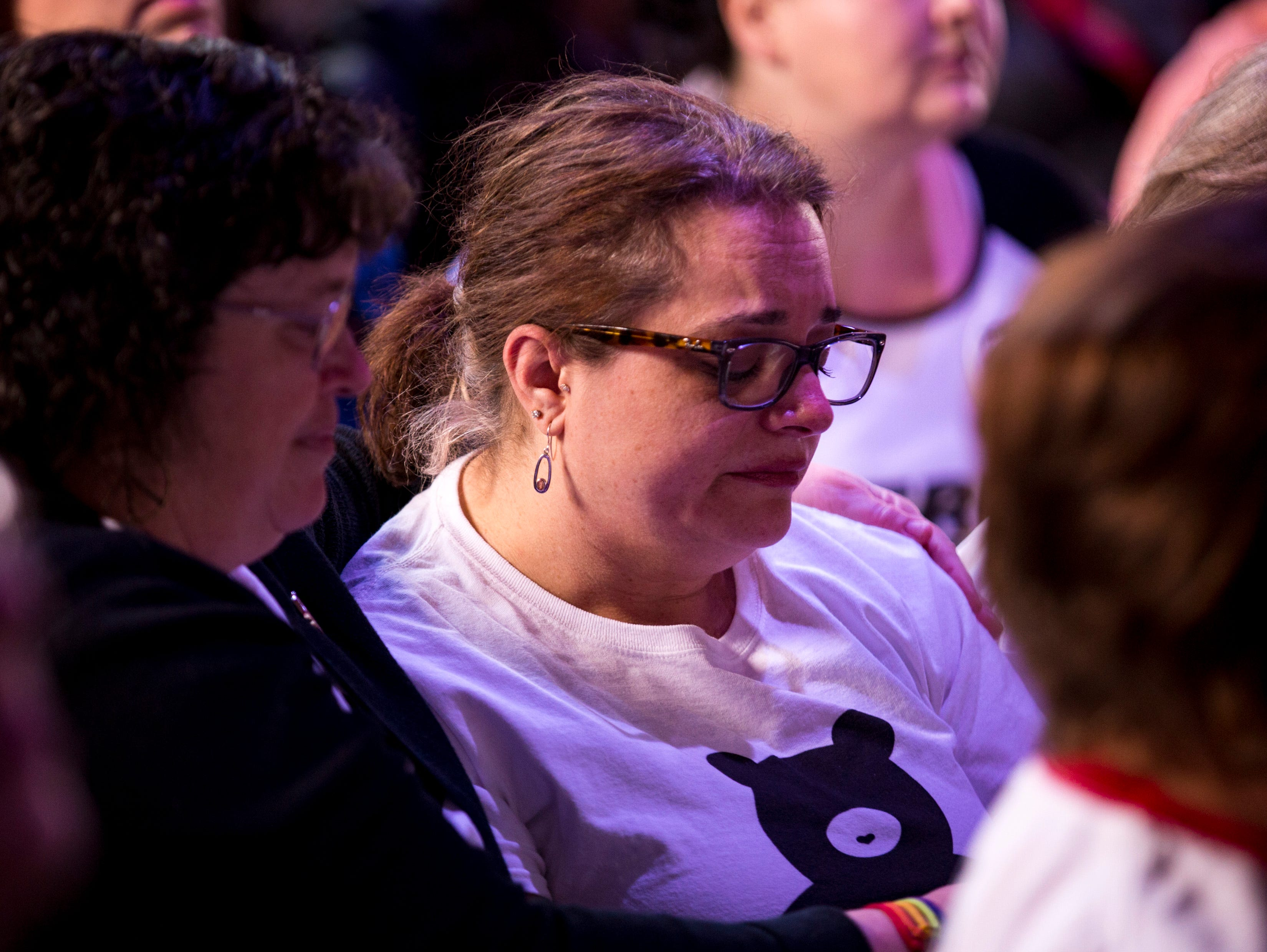 Heather Cluff is comforted as she starts to cry while the praise band performs at GracePointe Church in Nashville on Sunday, March 31, 2019.