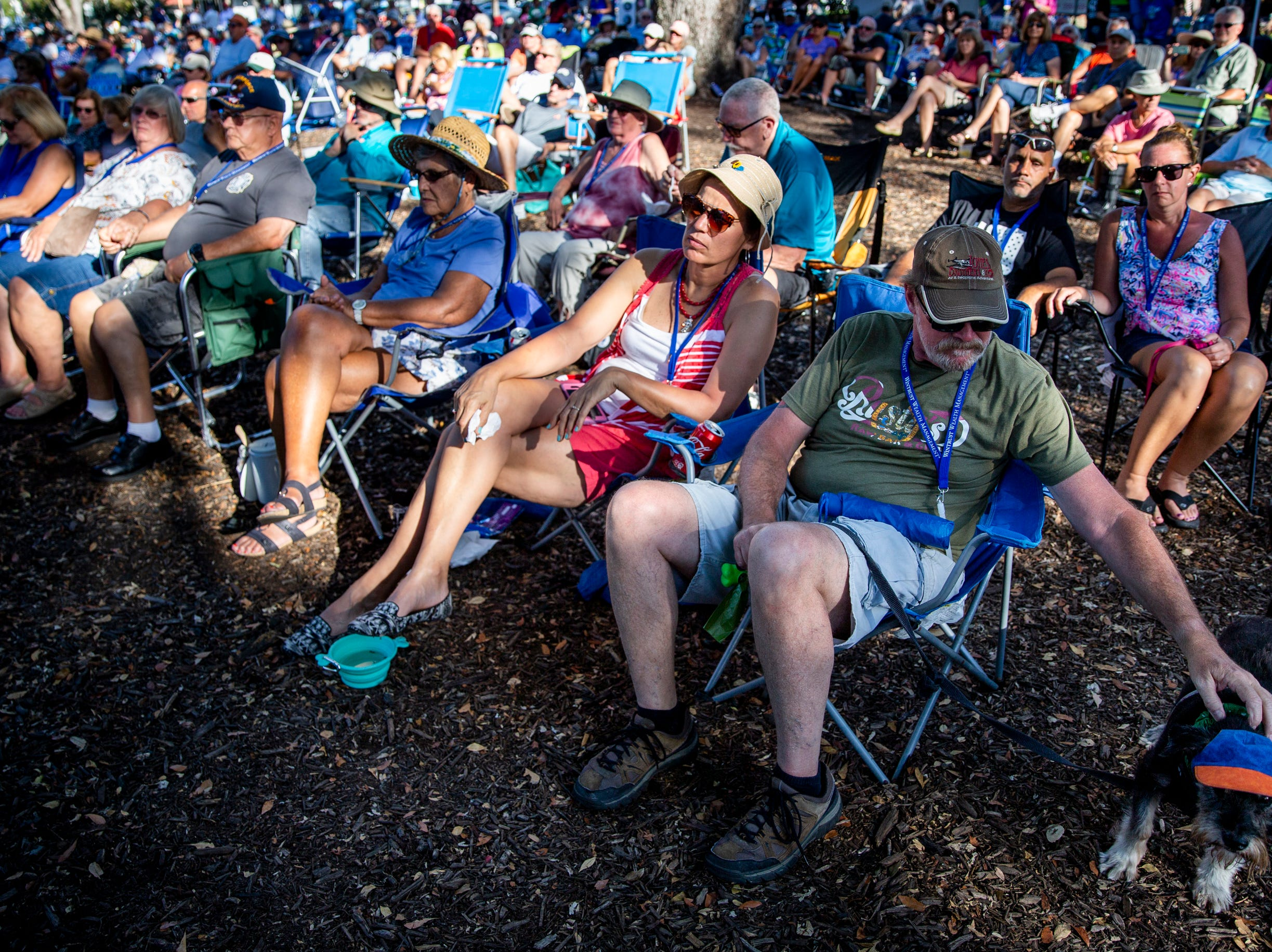Bob Gresham pets his dog, Jack, while he listens to a performance with his wife, Nancy Gresham, and her mother, Connie Schrader, during the first annual Blues for the Blue, a benefit concert raising funds for The Fallen Officers and The Robert L. Zore Foundation, at Cambier Park in Naples on Sunday, March 31, 2019.