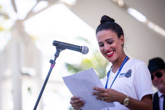 Rosemary Zore speaks during the first annual Blues for the Blue, a benefit concert raising funds for The Fallen Officers and The Robert L. Zore Foundation, at Cambier Park in Naples on Sunday, March 31, 2019. Zore was  7 years old when her father was killed in the line of duty, and she started The Robert L. Zore Foundation to honor his legacy.