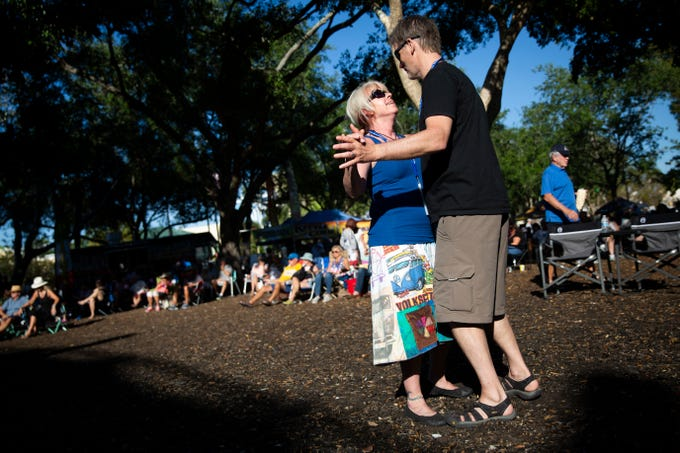 Retired Milwaukee police officer David Granica dances with Lisa Granica during the first annual Blues for the Blue, a benefit concert raising funds for The Fallen Officers and The Robert L. Zore Foundation, at Cambier Park in Naples on Sunday, March 31, 2019.