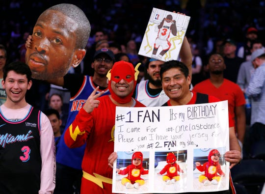 Miami Heat guard Dwyane Wade fans during the first half at Madison Square Garden.