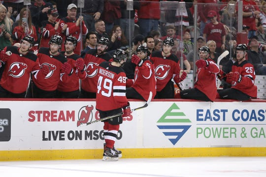 New Jersey Devils right wing Joey Anderson (49) celebrates his goal against the St. Louis Blues with teammates during the second period at Prudential Center.