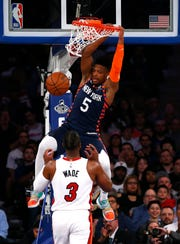 New York Knicks guard Dennis Smith Jr. (5) dunks over Miami Heat guard Dwyane Wade (3) during the first half at Madison Square Garden.