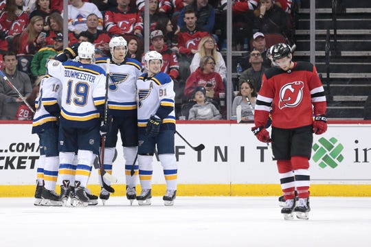 St. Louis Blues center Tyler Bozak (21) celebrates his goal against the New Jersey Devils with teammates during the second period at Prudential Center.