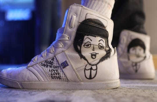Gary Glaser of East Windsor attended Beatlefest in Jersey City with a drawing of Paul McCartney on his shoe. Sunday, March 31, 2019