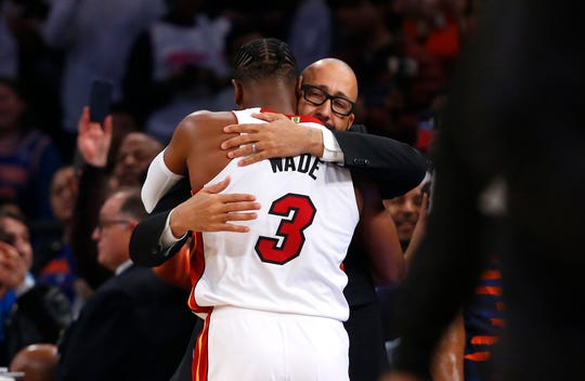 Miami Heat guard Dwyane Wade (3) receives a hug from New York Knicks head coach David Fizdale game at Madison Square Garden.