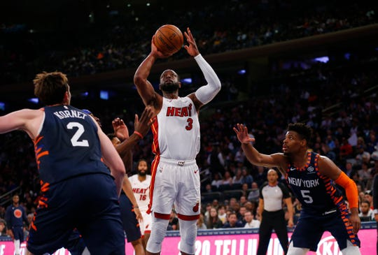 Miami Heat guard Dwyane Wade (3) goes to the basket against New York Knicks forward Luke Kornet (2) and guard Dennis Smith Jr. (5)  during the first half at Madison Square Garden.