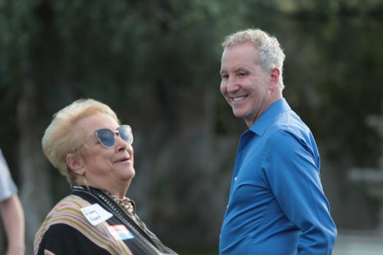 Former Palm Springs City Councilmember Ginny Foat shares a laugh with Councilmember Geoff Kors at a kickoff event for his reelection campaign, Palm Springs, Calif., March 30, 2019.