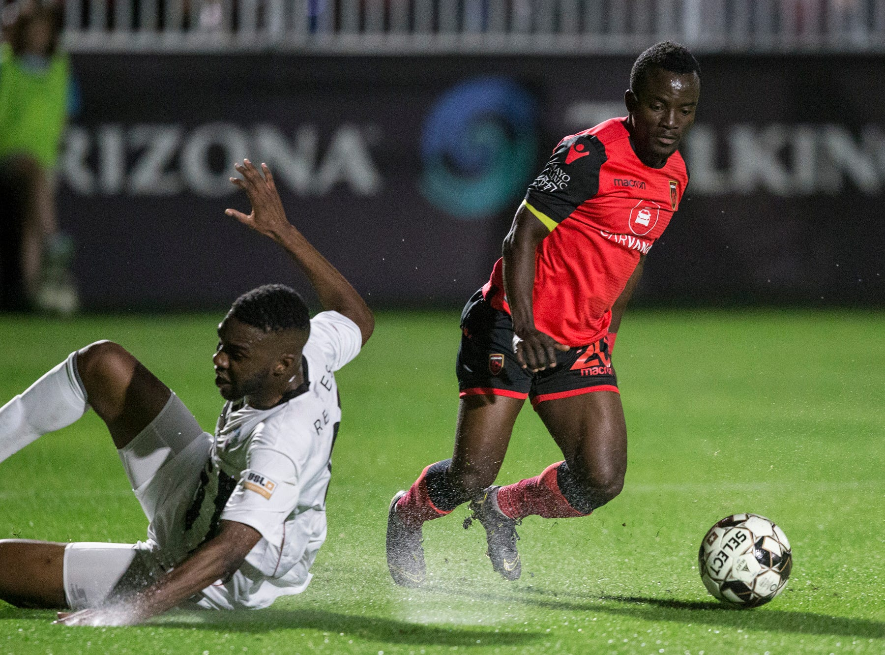 Phoenix Rising's Solomon Asante drives toward the goal against Colorado Springs in the first half on Saturday, Mar. 30, 2019, at Casino Arizona Field in Tempe, Ariz.