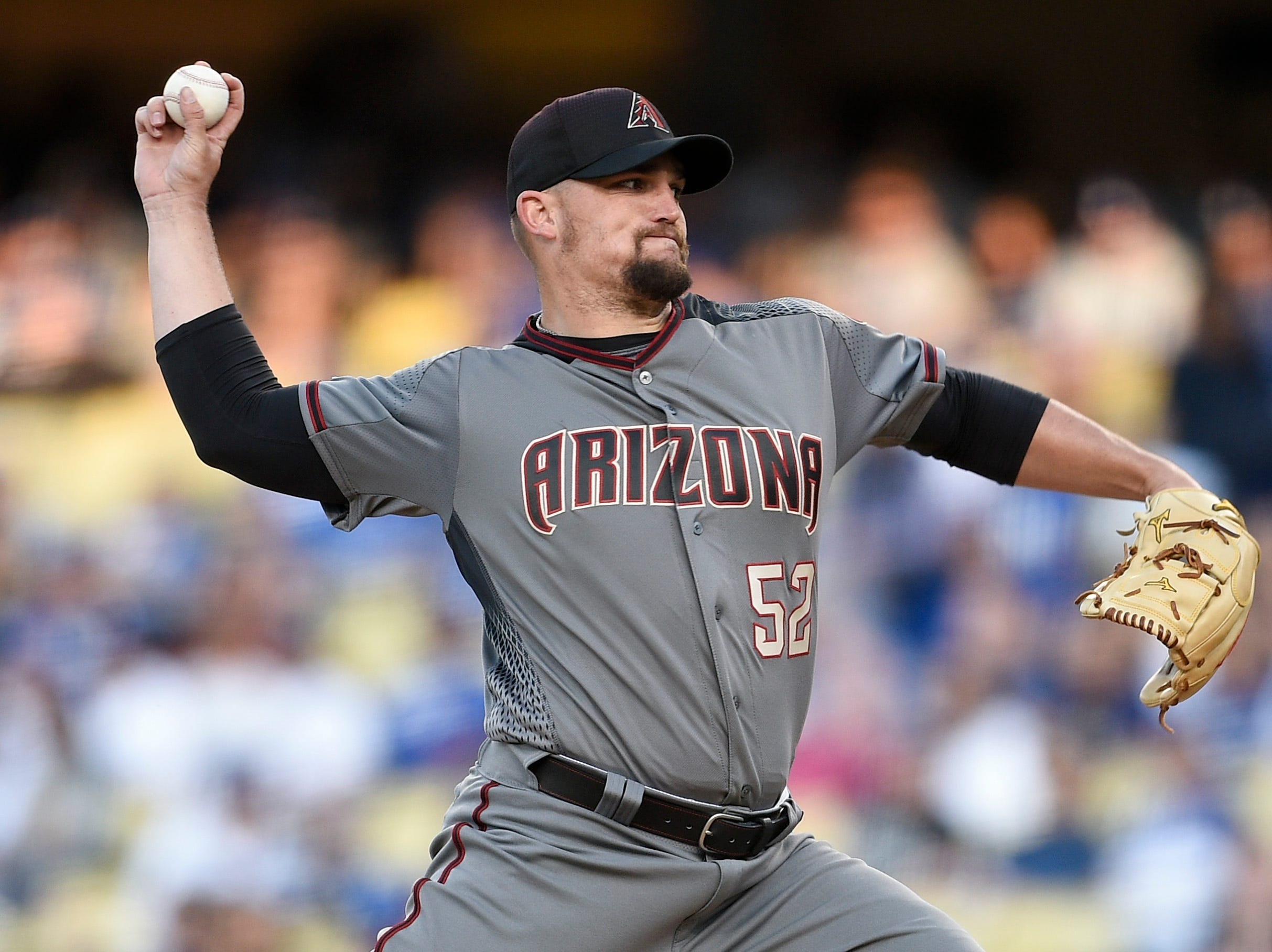 Mar 30, 2019; Los Angeles, CA, USA; Arizona Diamondbacks starting pitcher Zack Godley (52) pitches during the first inning against the Los Angeles Dodgers at Dodger Stadium. Mandatory Credit: Kelvin Kuo-USA TODAY Sports