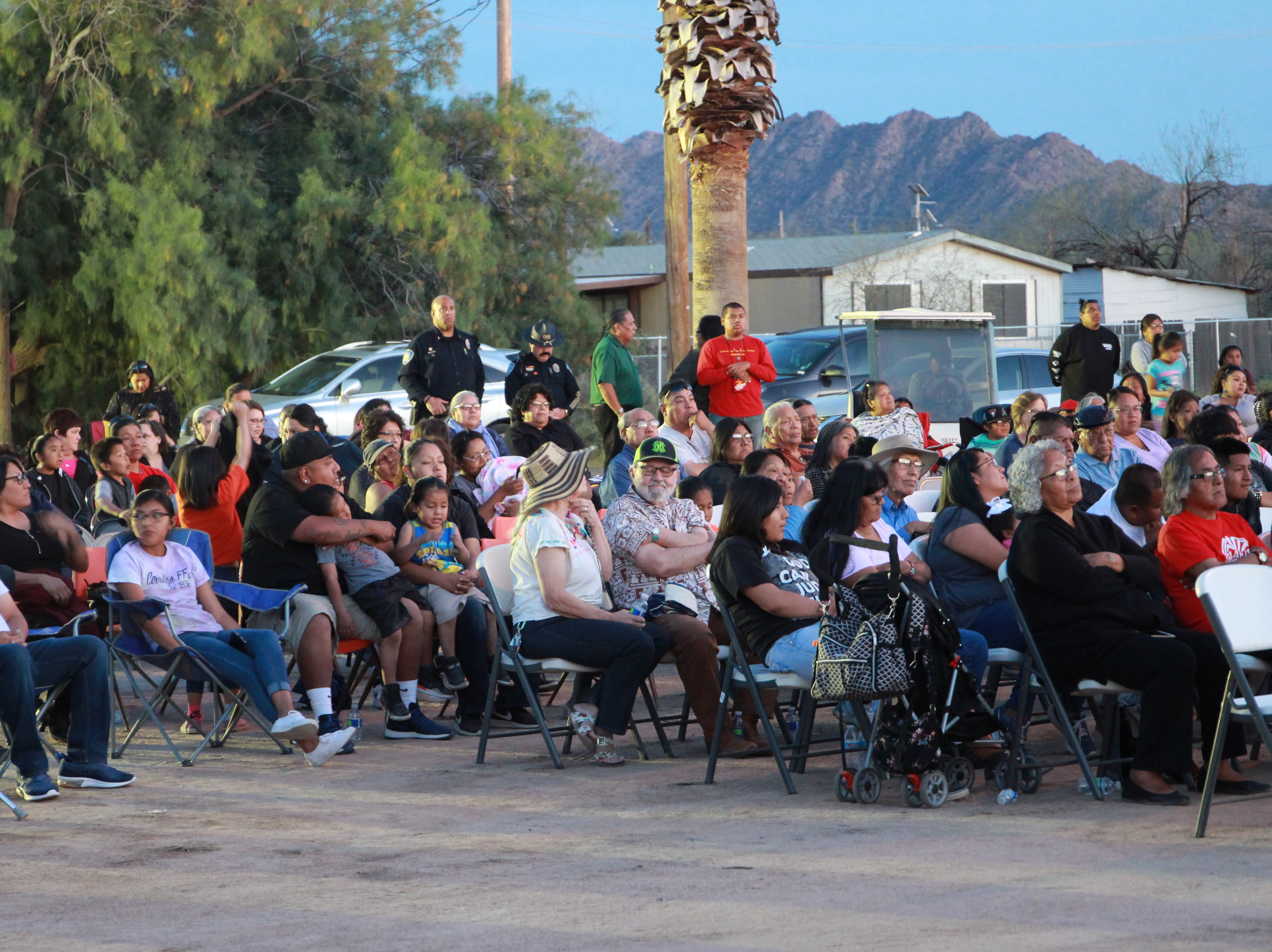 Sitting in the parking lot of the old church, members of the community prayed and remembered the old church.