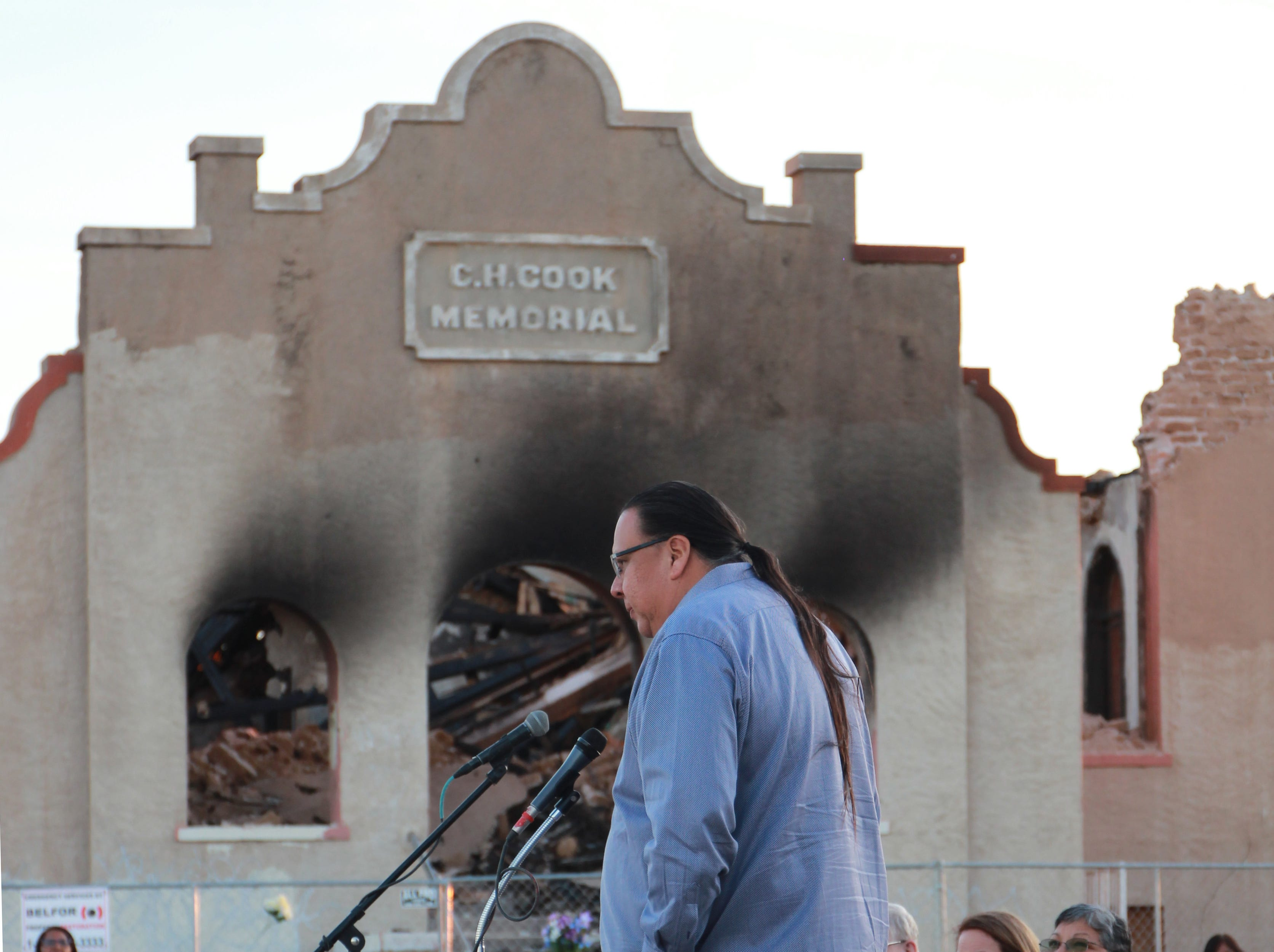 Governor Lewis speaks upon his memories of the church at the prayer vigil.