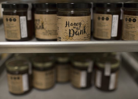Products from cannabis cuisine company Flourish sit on a shelf at the Harvest facility lab in Bellemont, Ariz. on Feb. 7. 2018. The oils are worth thousands of dollars.