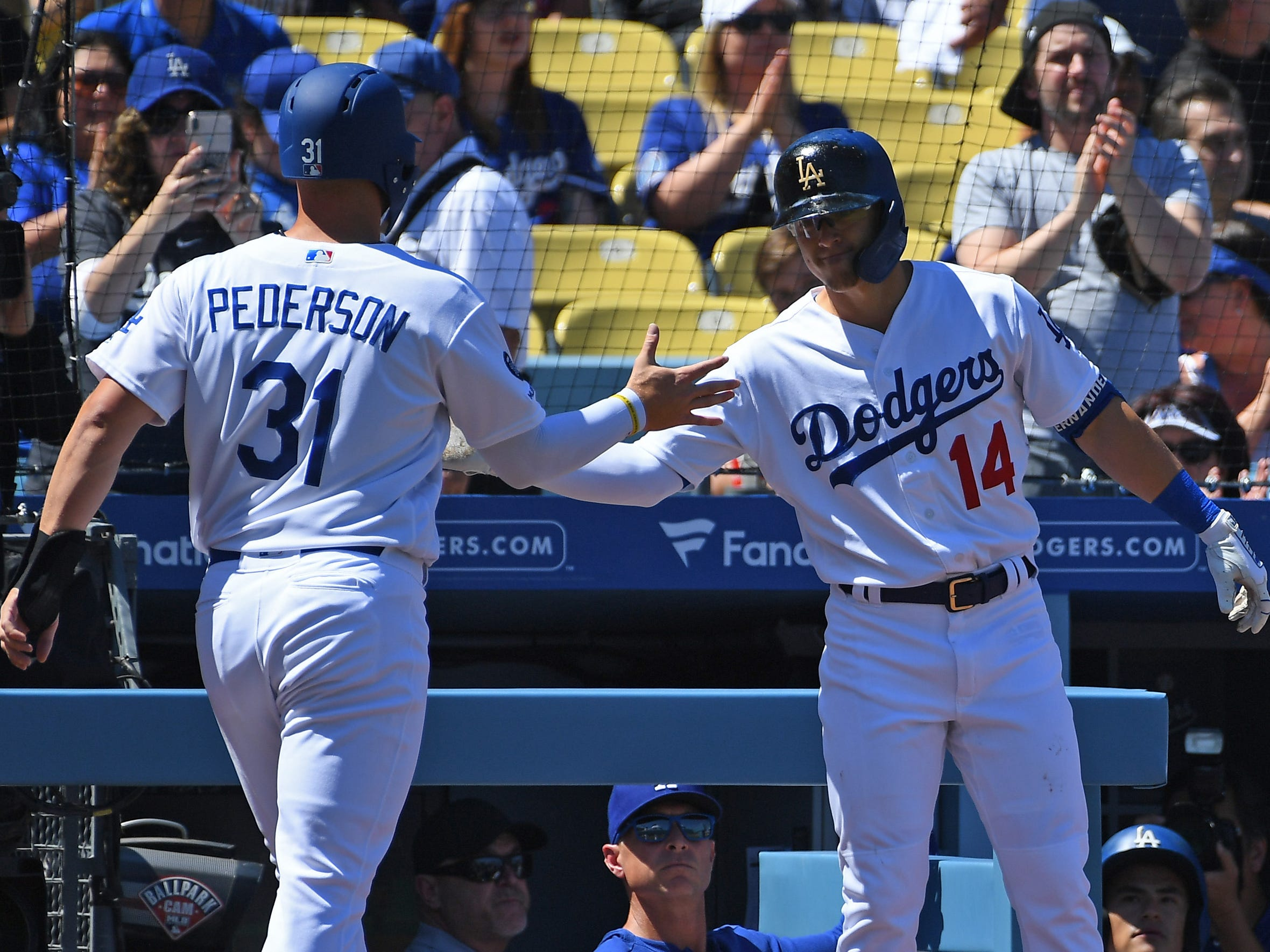 Mar 31, 2019; Los Angeles, CA, USA; Los Angeles Dodgers left fielder Joc Pederson (31) shakes hands with center fielder Enrique Hernandez (14) after scoring on a sacrifice fly in the first inning against the Arizona Diamondbacks at Dodger Stadium.