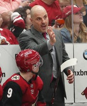 Arizona Coyotes head coach Rick Tocchet instructs center Clayton Keller (9) during the second period against the Minnesota Wild in Glendale March 31, 2019.