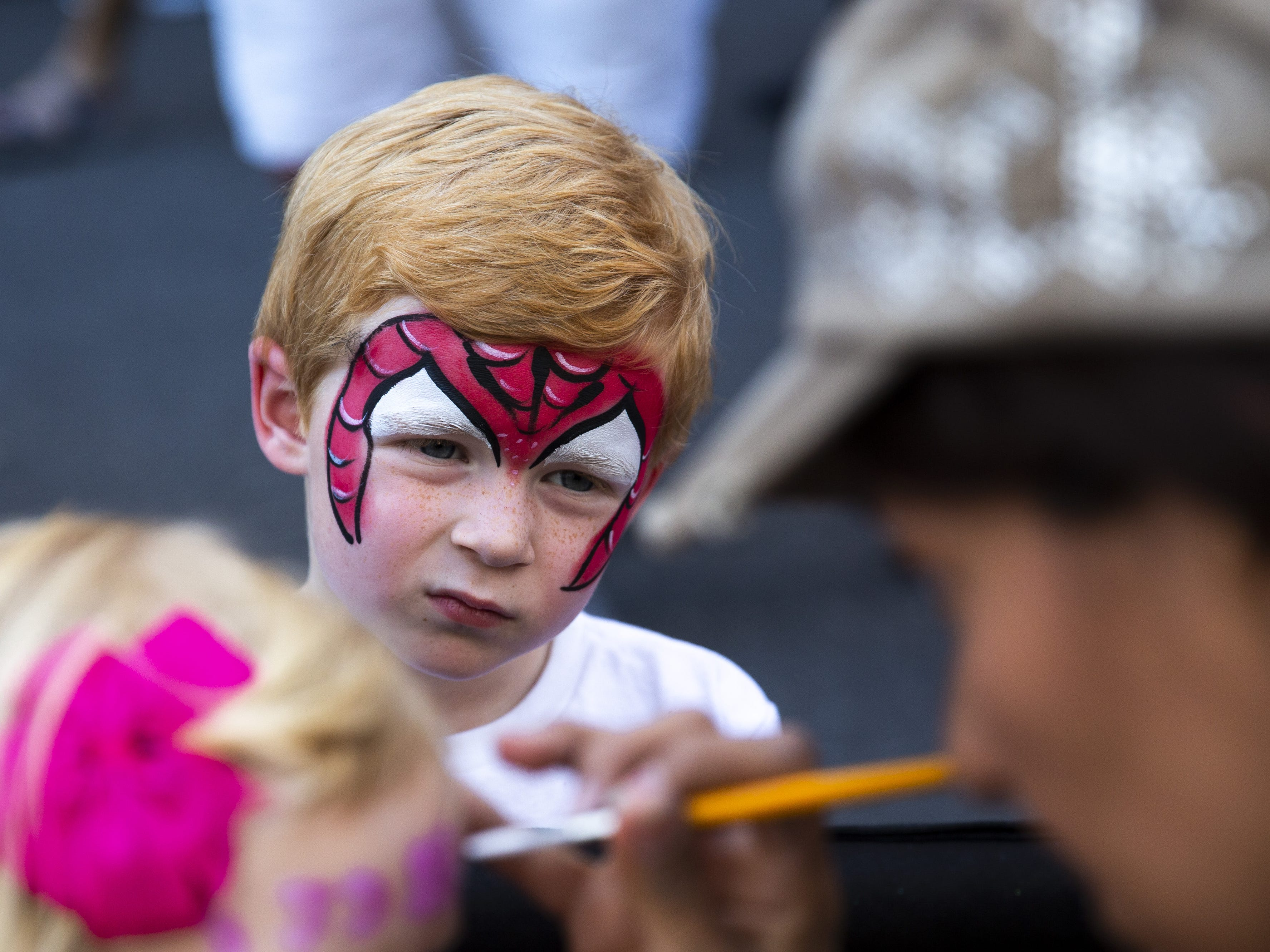 Quinn DeMeritt, 5, wears a Spiderman shirt and has Spiderman face paint in the kids block, located between Fifth and Sixth Streets, during the Spring Tempe Festival of the Arts on Saturday, March 30, 2019.