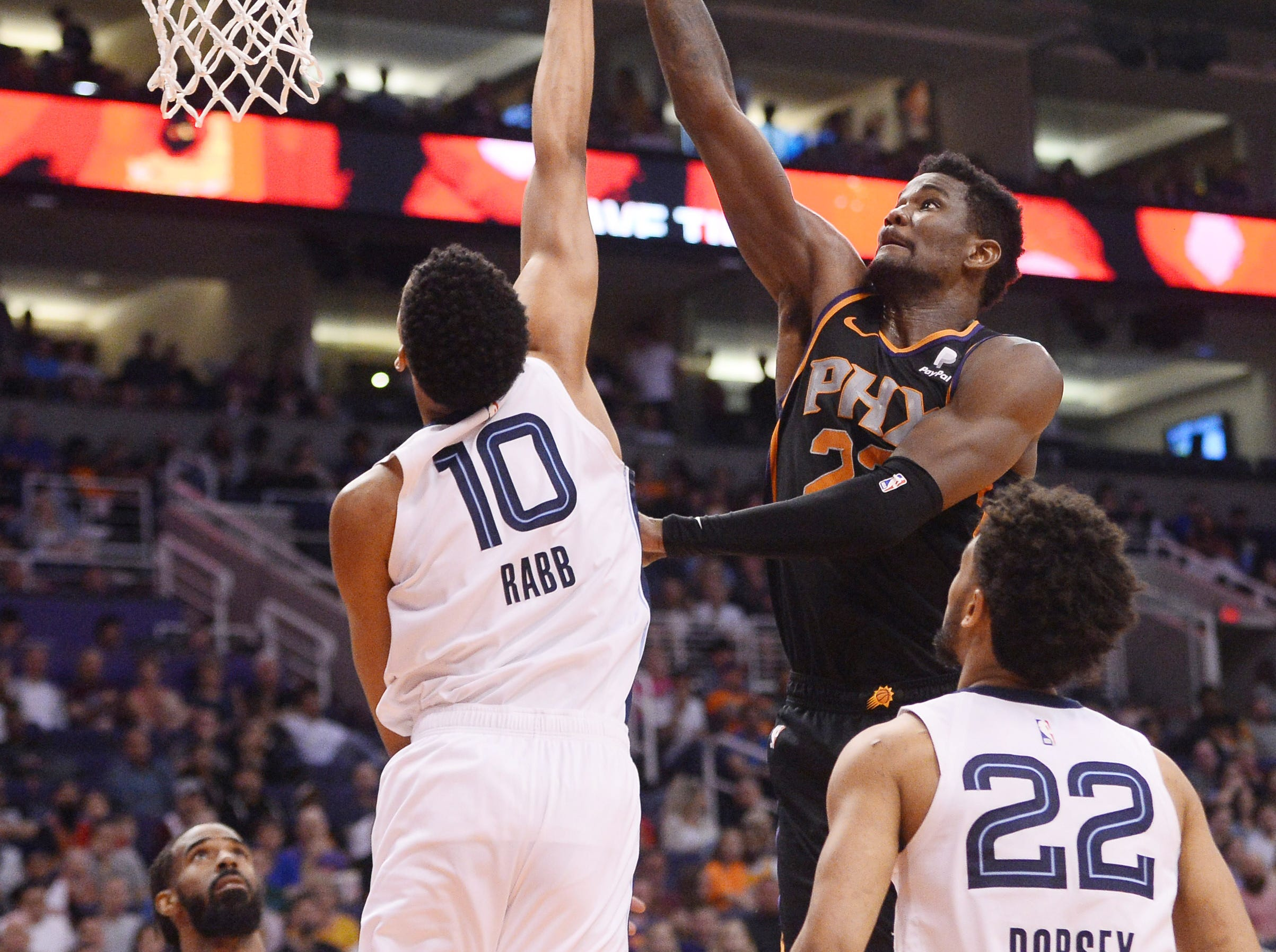 Mar 30, 2019; Phoenix, AZ, USA; Phoenix Suns center Deandre Ayton (22) shoots over Memphis Grizzlies forward Ivan Rabb (10) during the first half at Talking Stick Resort Arena. Mandatory Credit: Joe Camporeale-USA TODAY Sports
