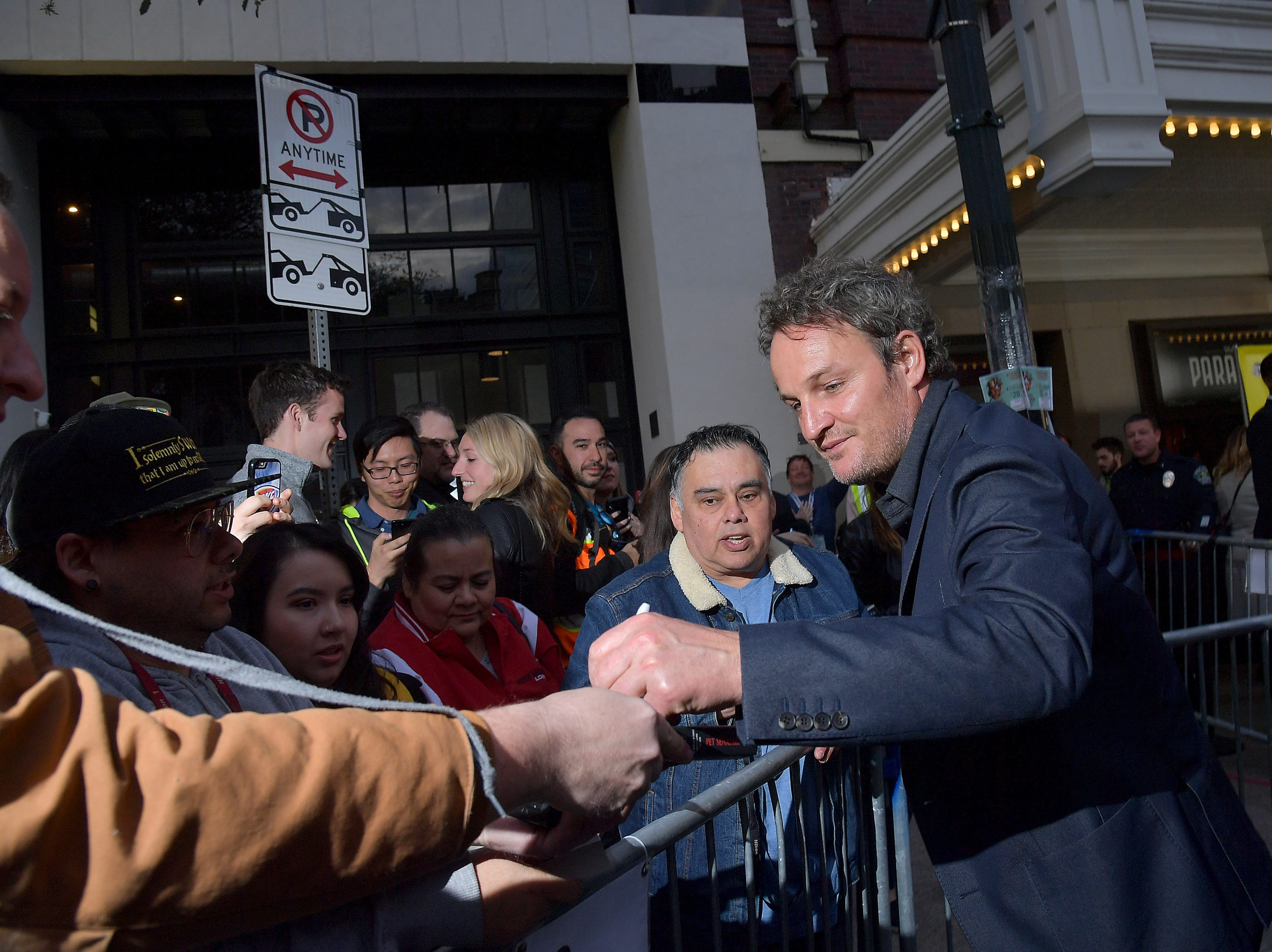 "Jason Clarke greets fans at the ""Pet Sematary"" premiere on March 16, 2019, in Austin."